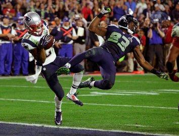 New England Patriots strong safety Malcolm Butler (21) intercepts a pass intended for Seattle Seahawks wide receiver Ricardo Lockette (83) during the second half of NFL Super Bowl XLIX football game on Feb. 1, 2015, in Glendale, Ariz.