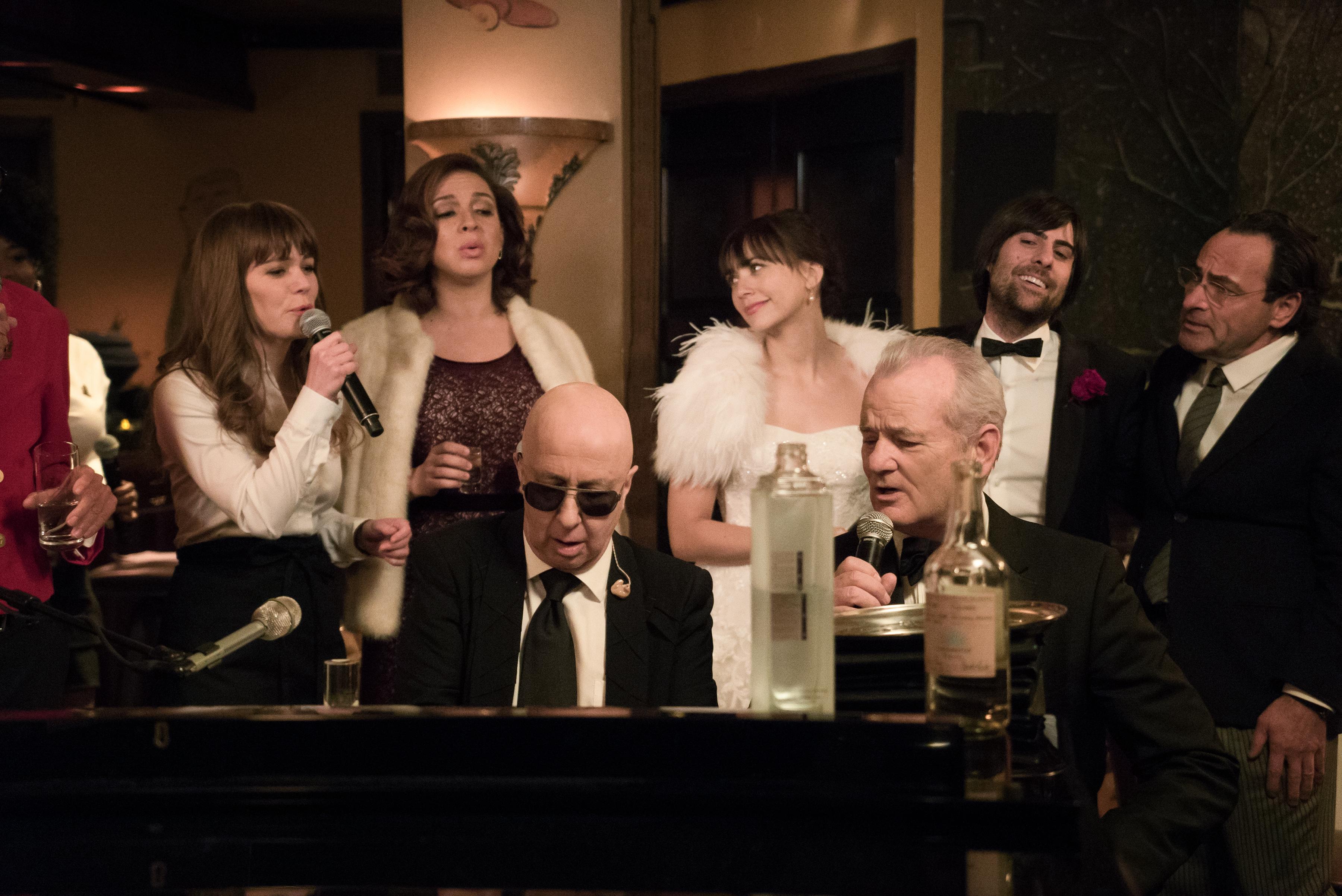 From left: Jenny Lewis, Maya Rudolph, Paul Shaffer, Rashida Jones, Bill Murray, Jason Schwartzman, and Dimitri Dimitrov in A Very Murray Christmas.