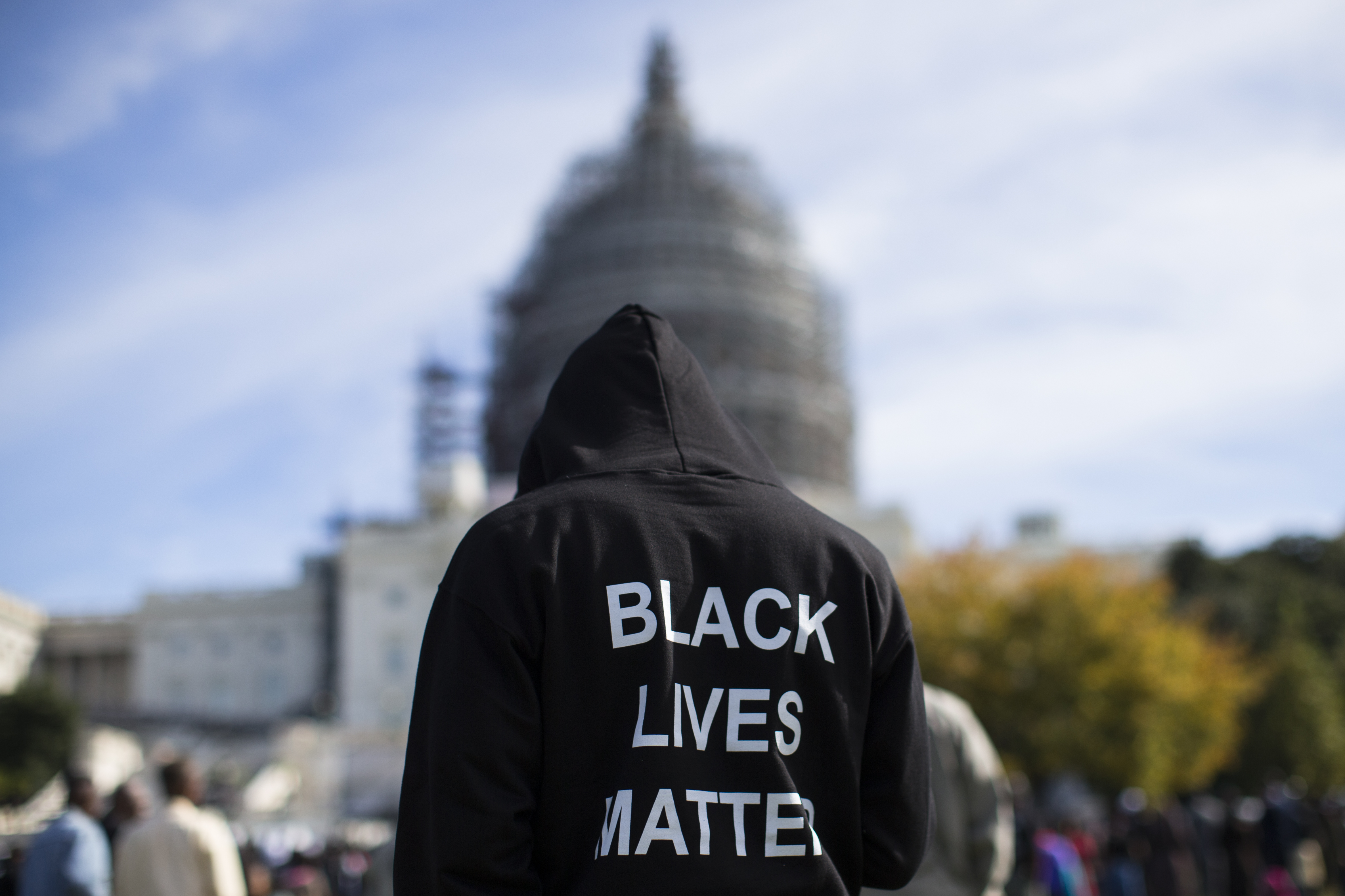 Neal Blair, of Augusta, Ga. stands on the lawn of the Capitol building during a rally to mark the 20th anniversary of the Million Man March, on Capitol Hill, on Oct. 10, 2015, in Washington.