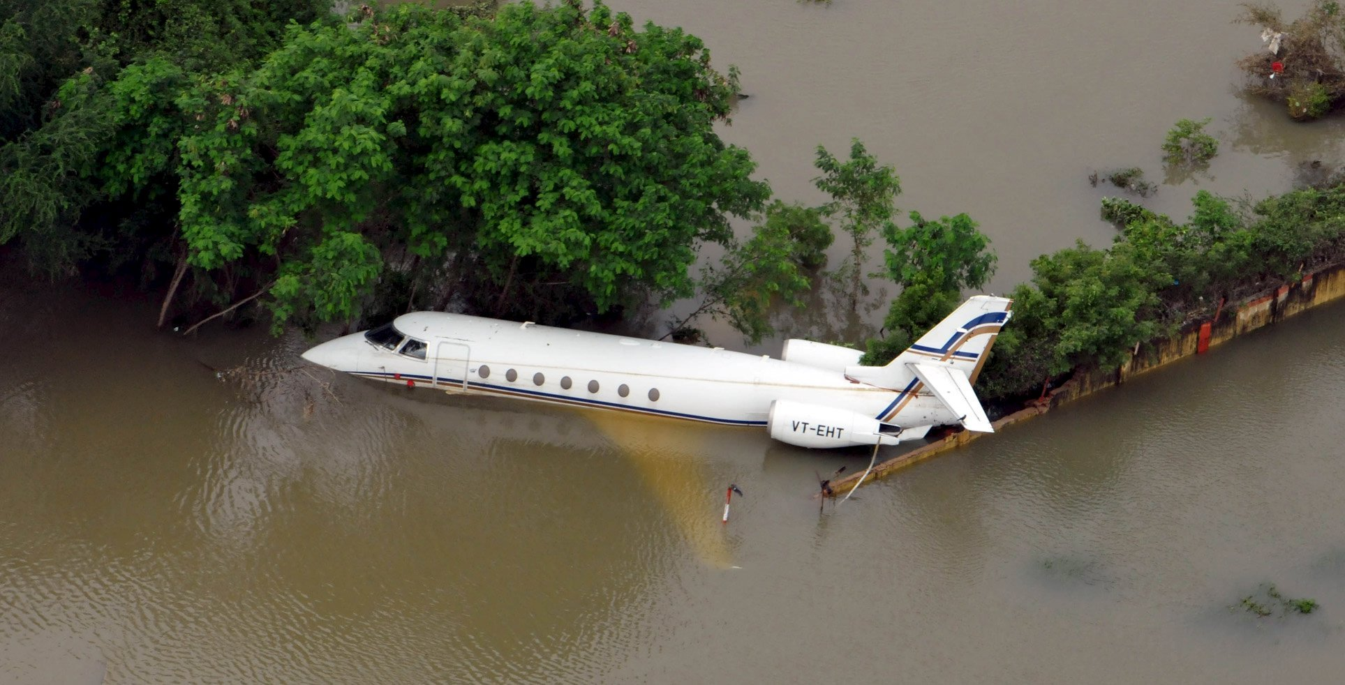 An aerial view of a partially submerged airplane is pictured in a flood affected area in Chennai, India on Dec. 3, 2015.