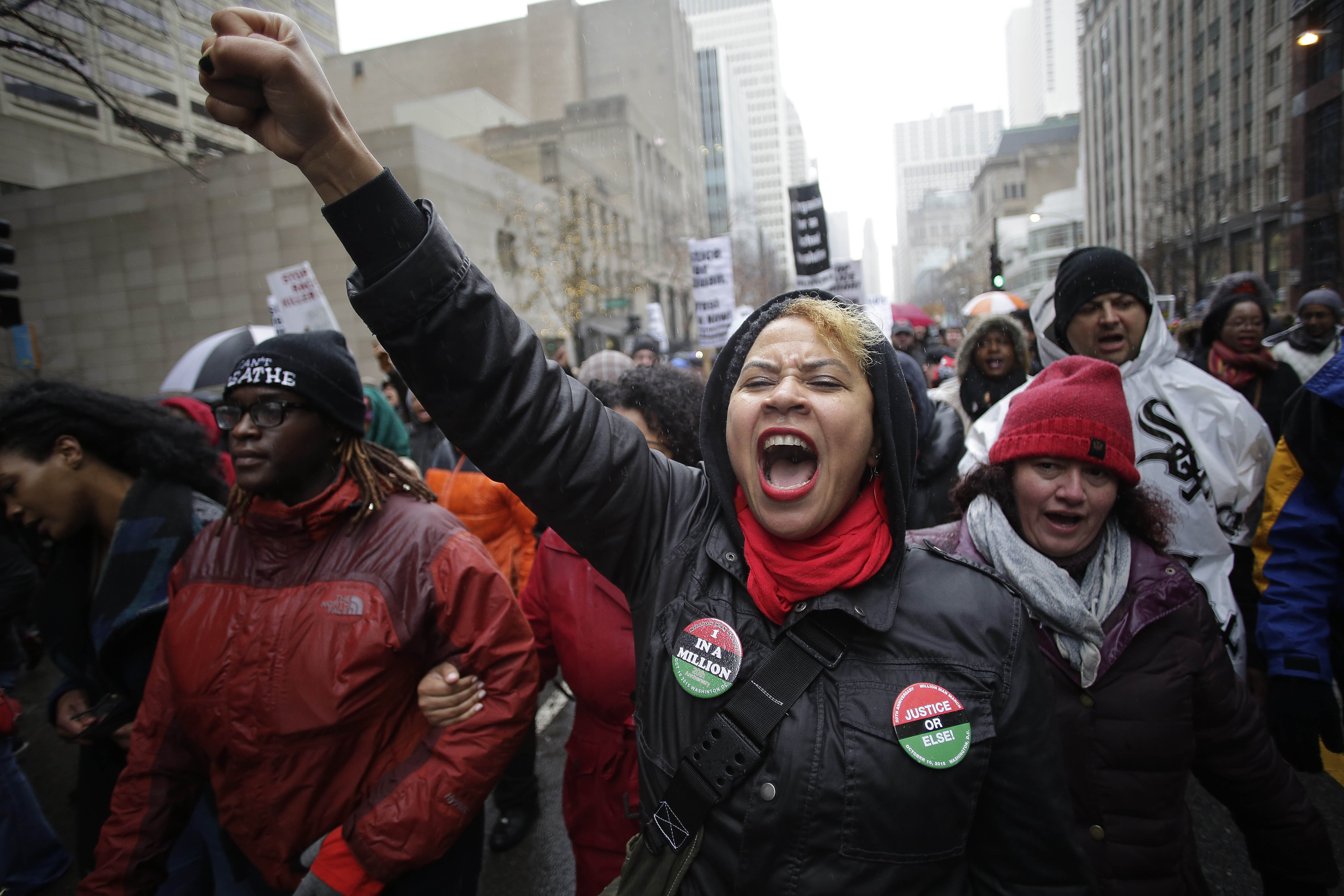 Demonstrators protest the shooting of Laquan McDonald along the Magnificent Mile in Chicago on Nov. 27, 2015.