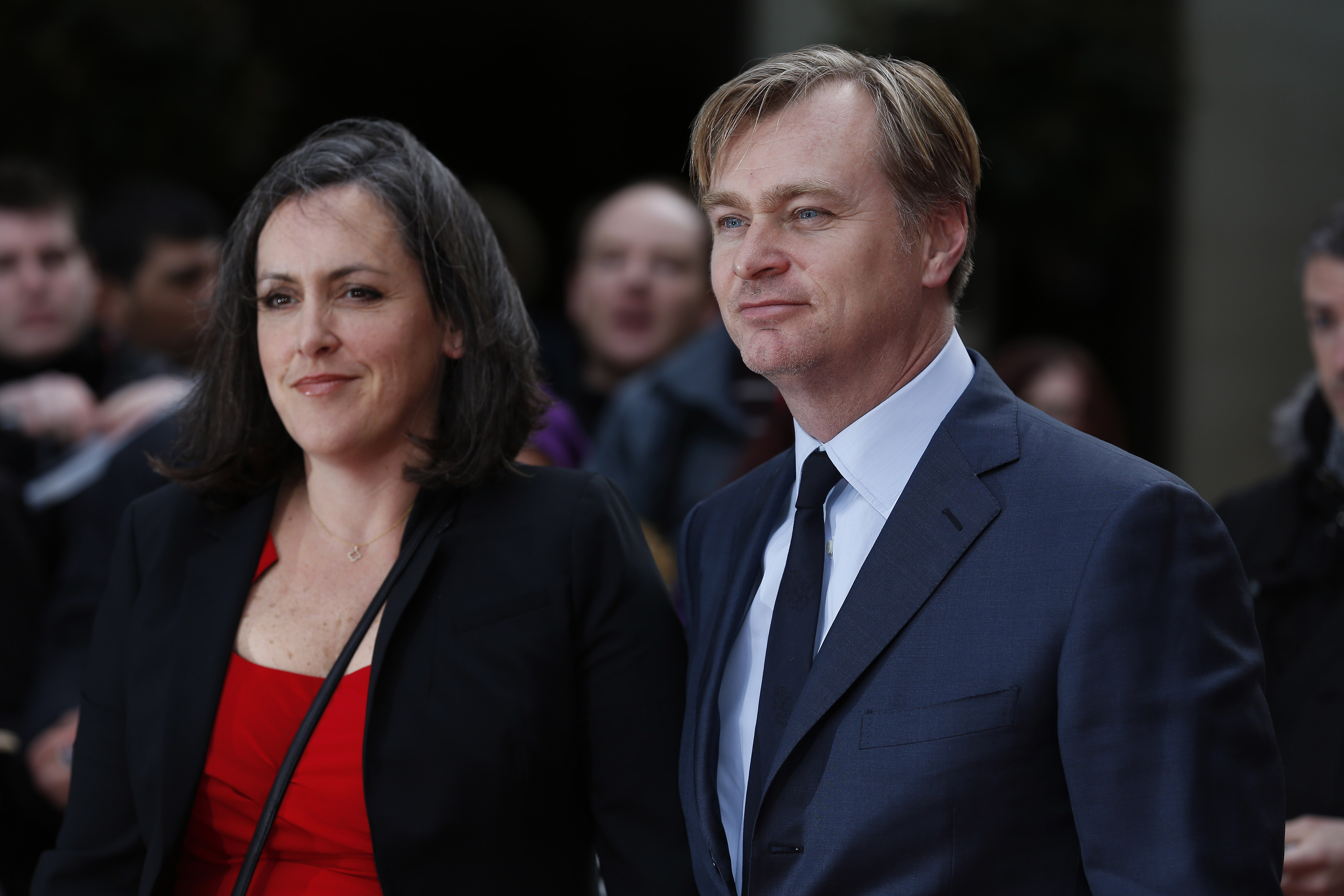 British director Christopher Nolan (R) and his wife, British film producer Emma Thomas pose for photographers as they arrive for the 2015 Empire Awards in central London on Mar. 29, 2015.