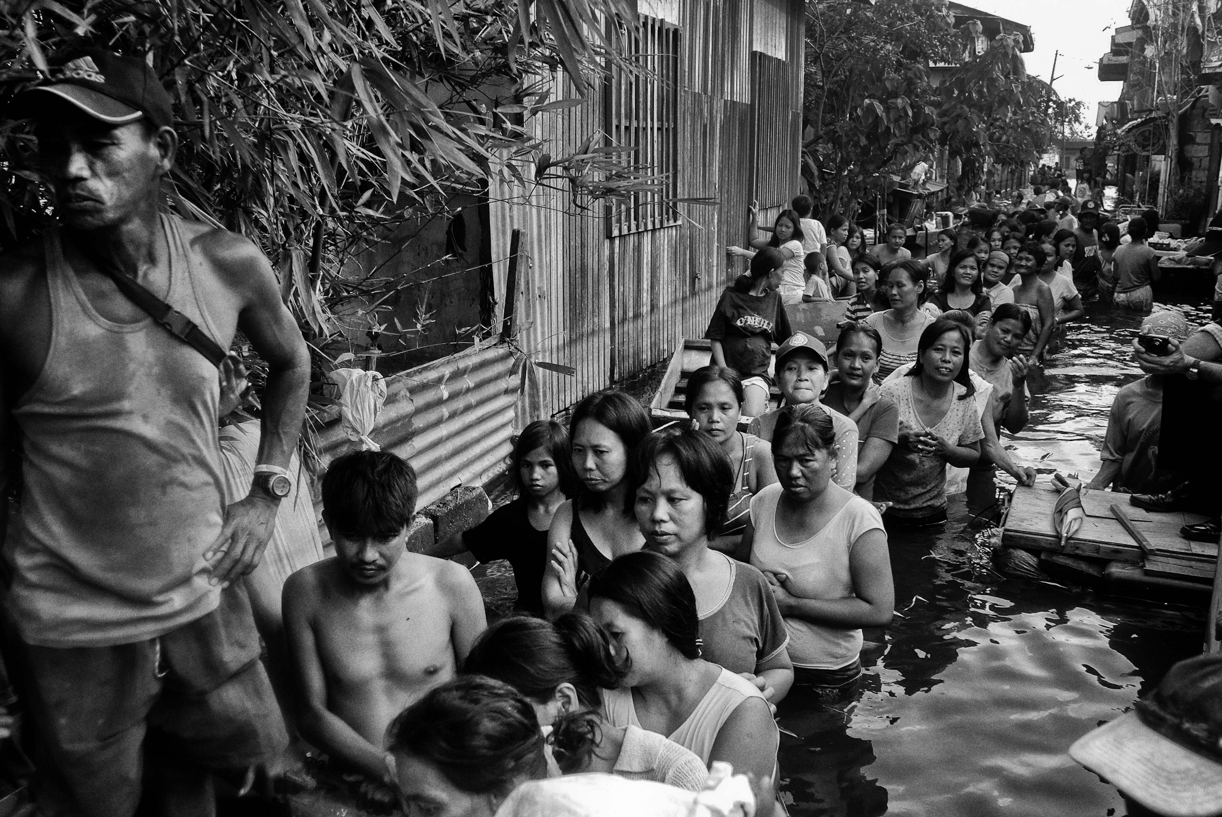 Relief packs are distributed in a flooded district of Taguig, Phillipines on Oct. 12, 2009. Typhoon Ketsana, known in the Philippines as Tropical Storm Ondoy, devastated the region in 2009.