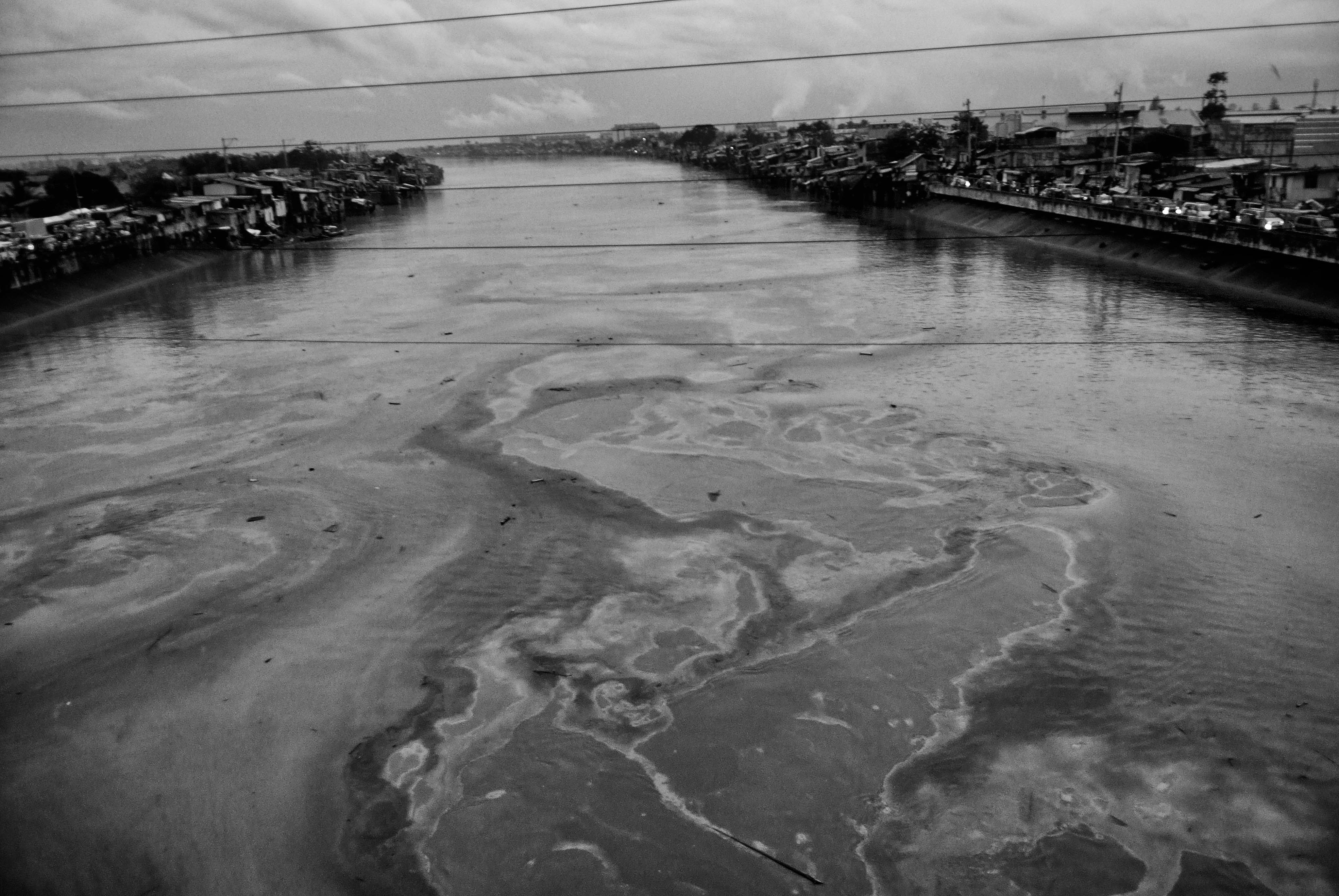 Pollution is visible on the Pasig River following Typhoon Ketsana on Sept. 28, 2009.