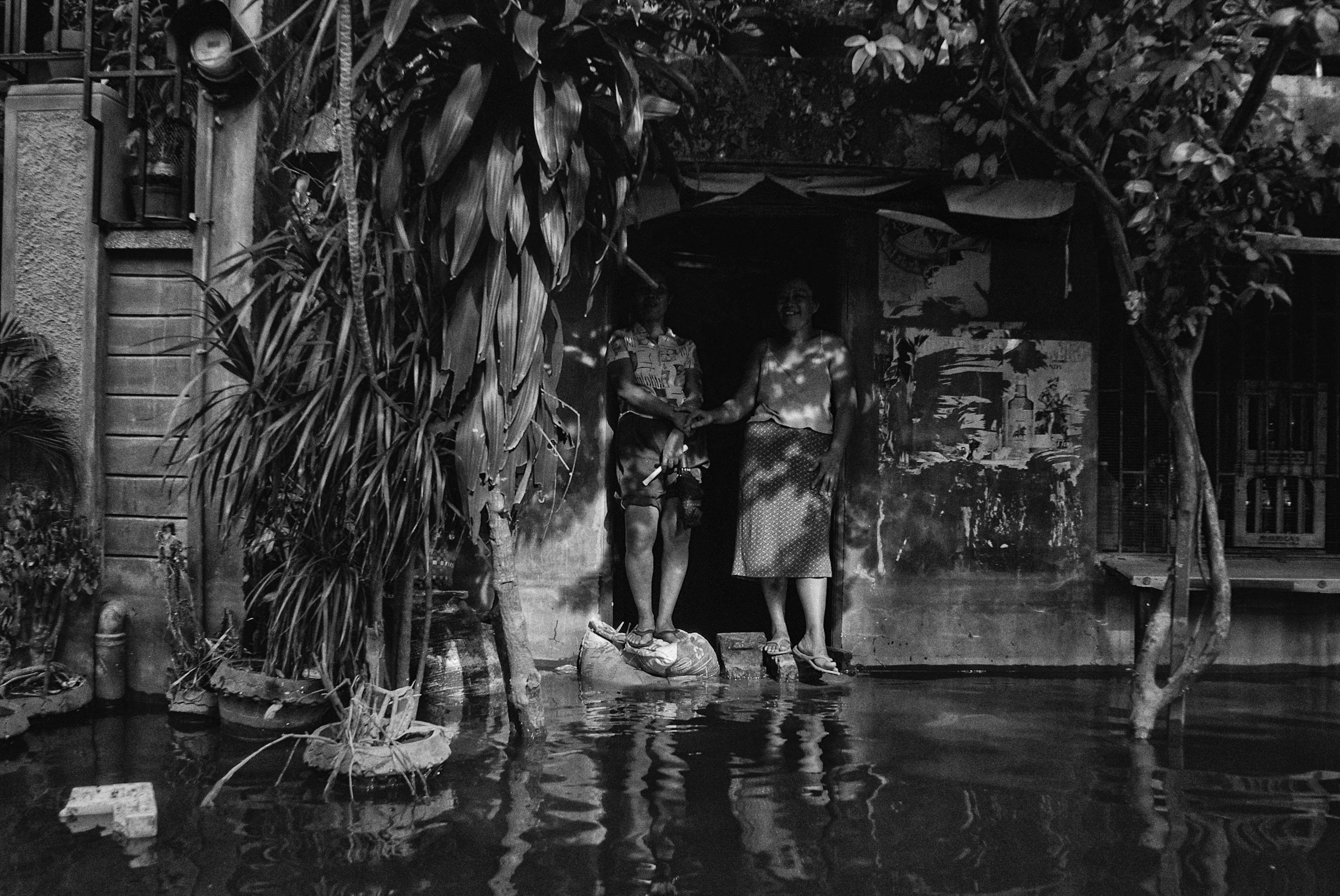 Residents wait for relief packs in Taguig city as floodwaters inundate their access to the town center on Oct. 10, 2009.