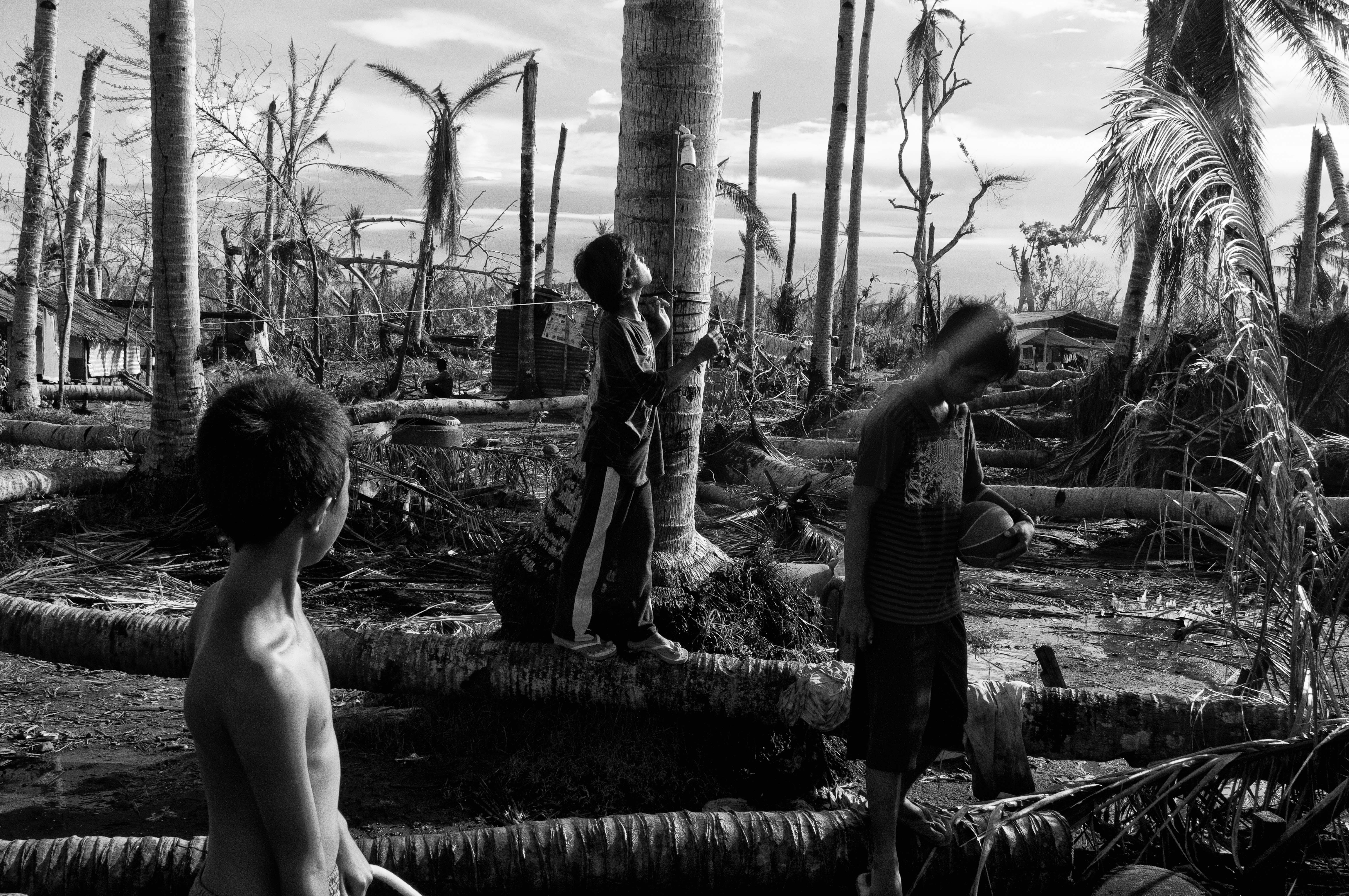Children play in a damaged village in San Joaquin, Leyte on Dec. 10, 2013.a