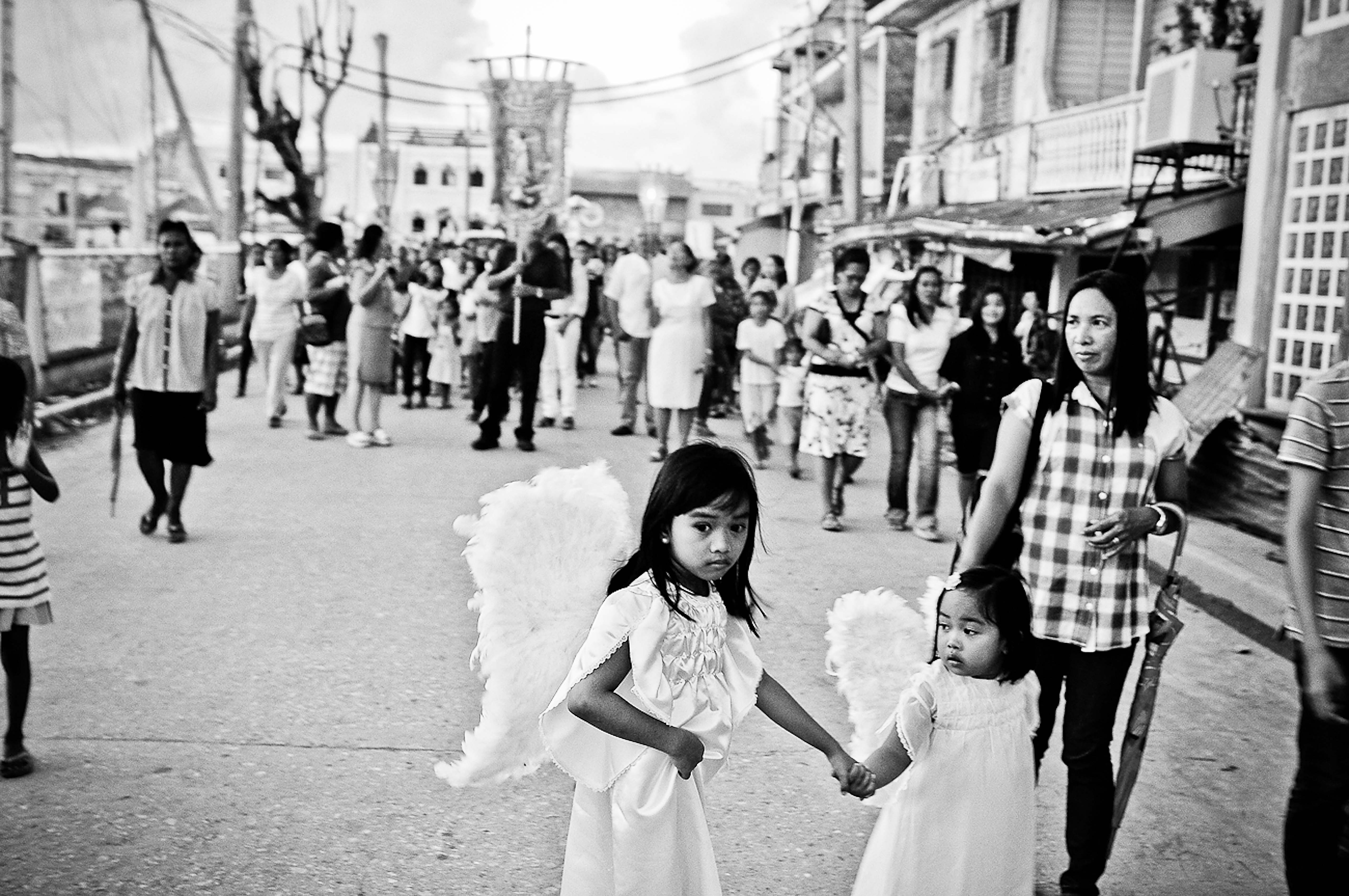 A Roman Catholic procession is held in Guiuan town a month after Typhoon Haiyan made its first landfall in the area in Dec. 2013.