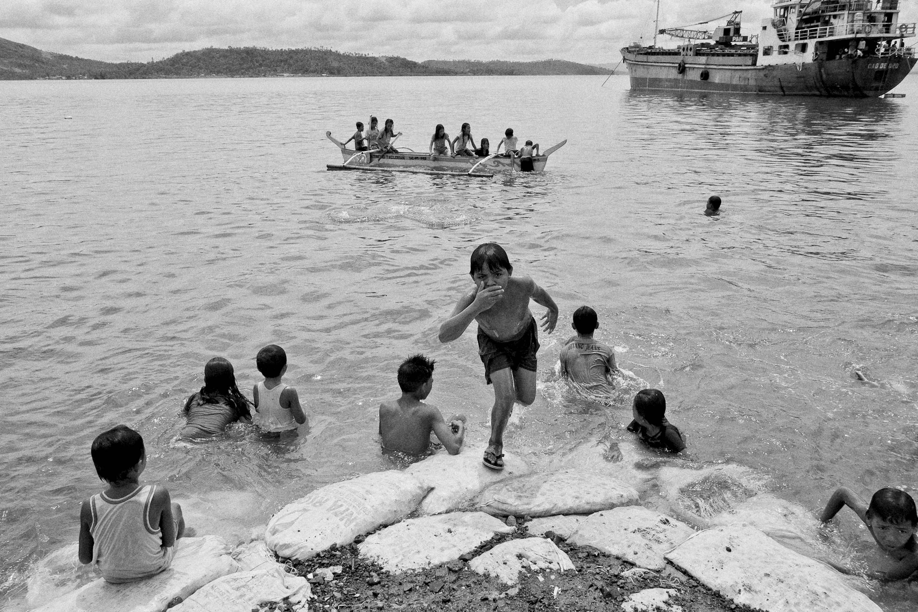 Children take a dip along the coast of Leyte on June 30, 2014.