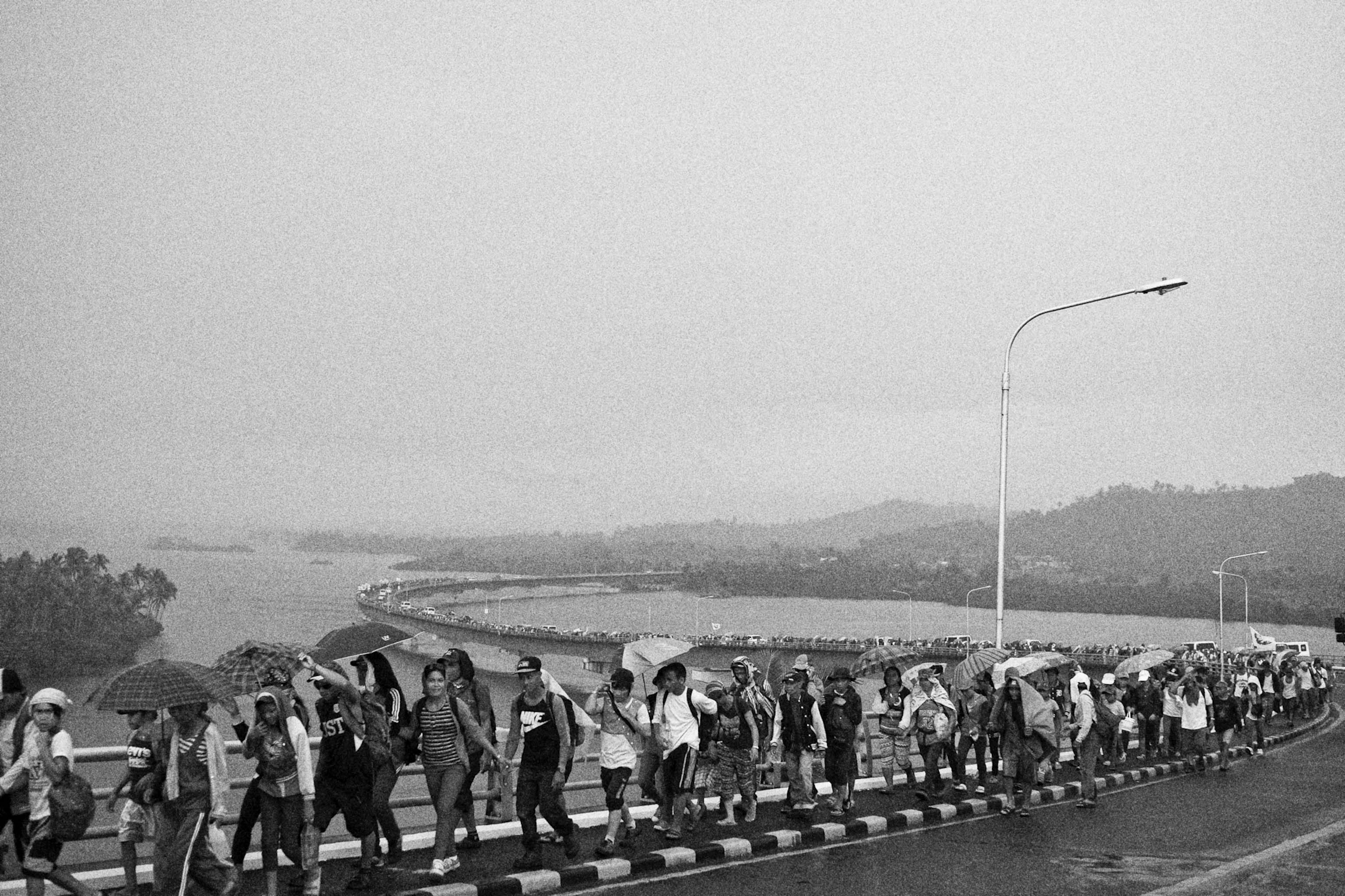 Protesters from different parts of Visayas cross the San Juanico Bridge on Nov. 7, 2014, to meet with other survivors of disasters converging to mark the first year anniversary of Typhoon Haiyan.