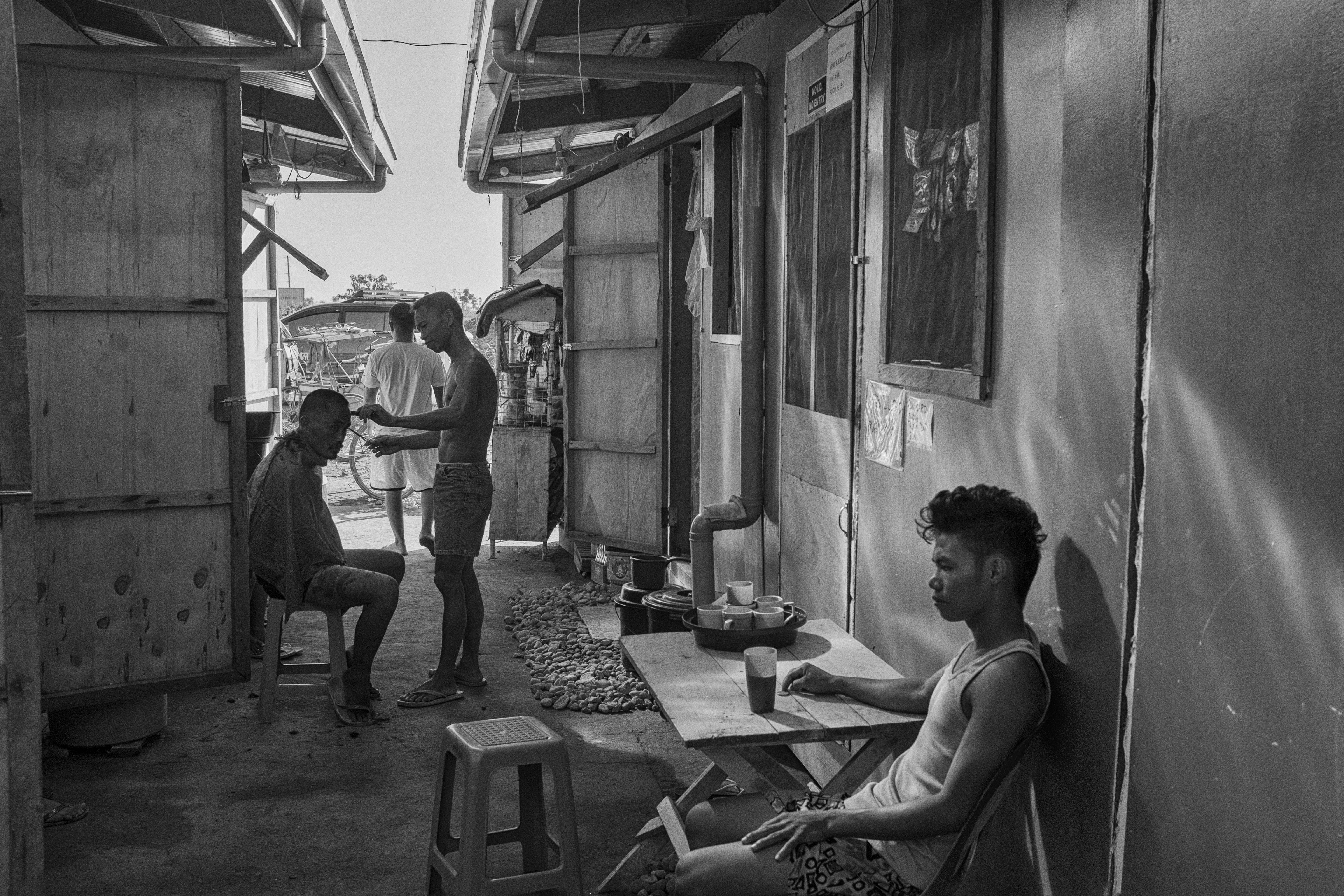 Residents go about their morning routines at a temporary bunkhouse in Tacloban City on April 26, 2014.