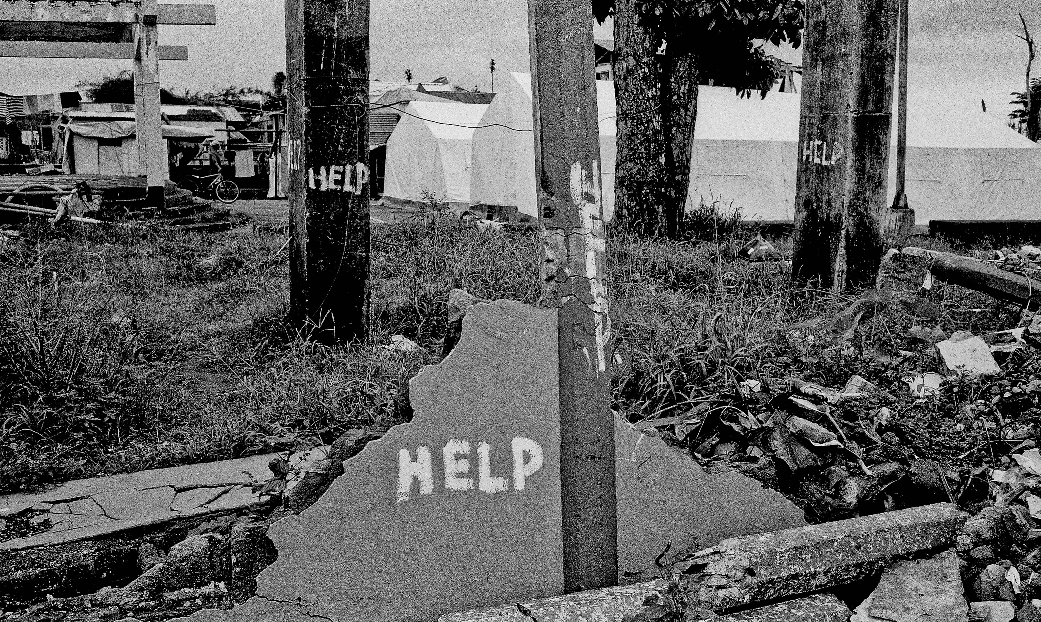 A call for help is painted on pillars in San Joaquin, Feb. 15, 2014.