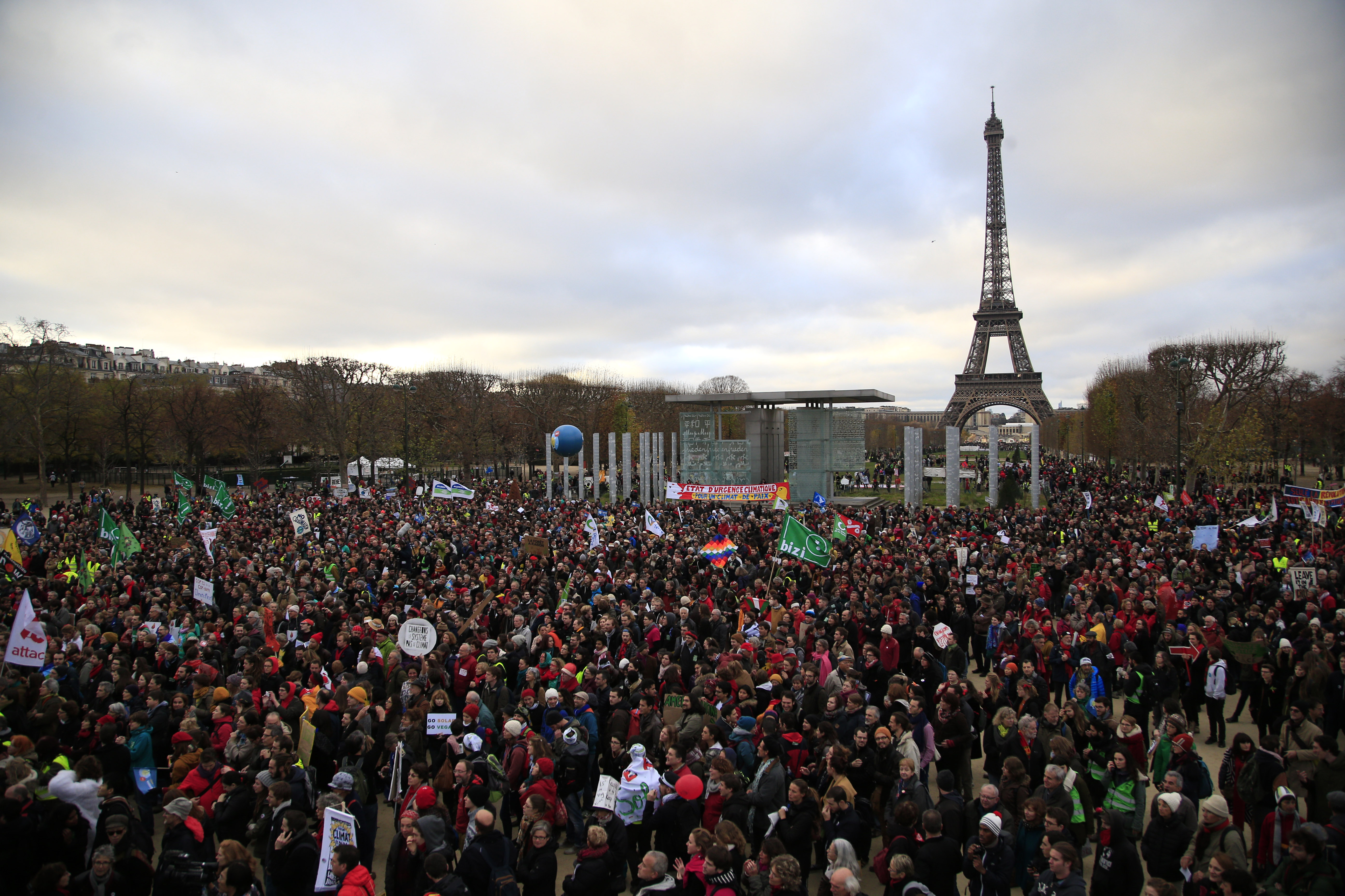 Activists gather near the Eiffel Tower in Paris on Dec.12, 2015.
