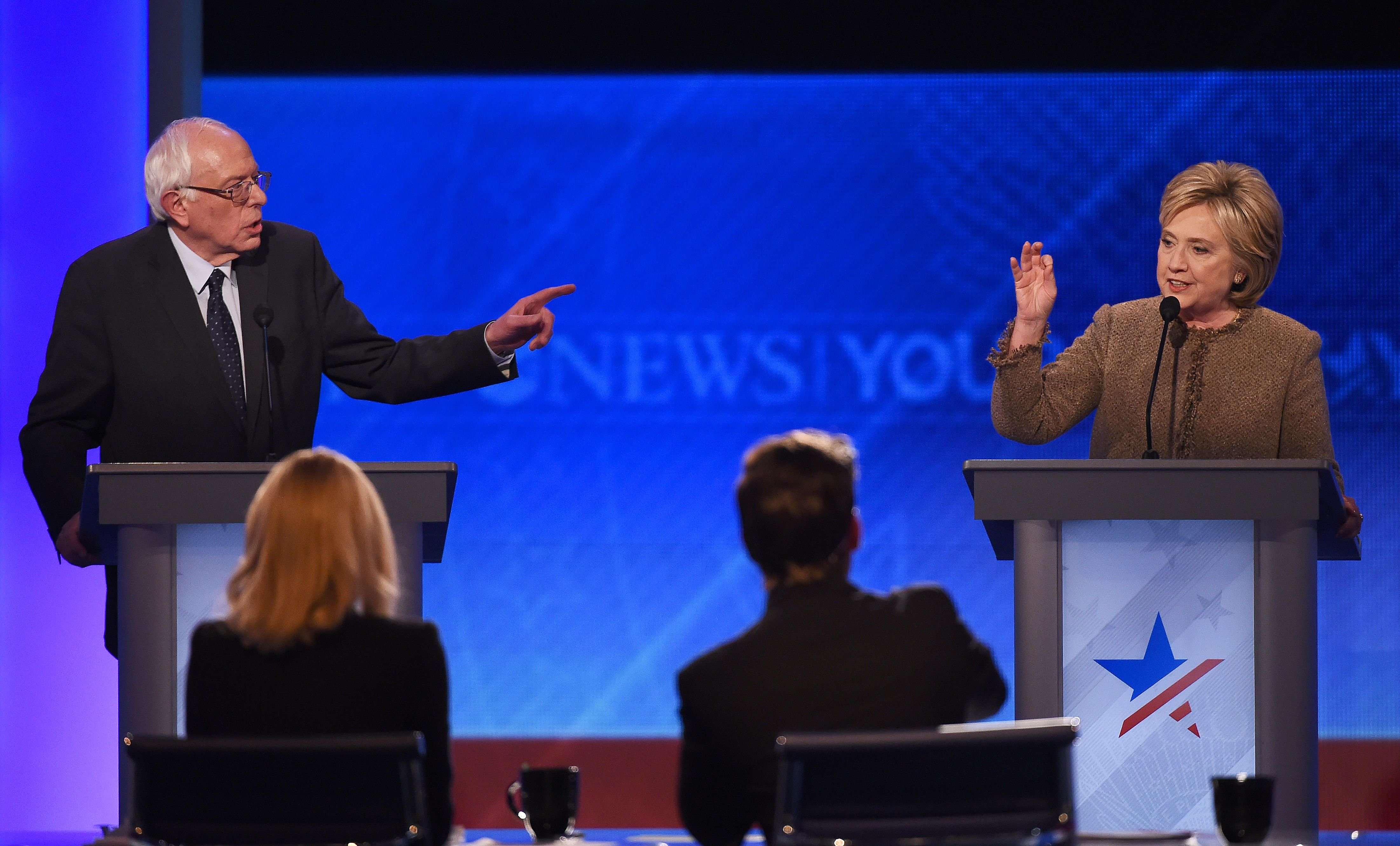 Hillary Clinton, right, and Bernie Sanders participate in the Democratic Presidential Debate hosted by ABC News at Saint Anselm College in Manchester, New Hampshire, on Dec. 19, 2015.