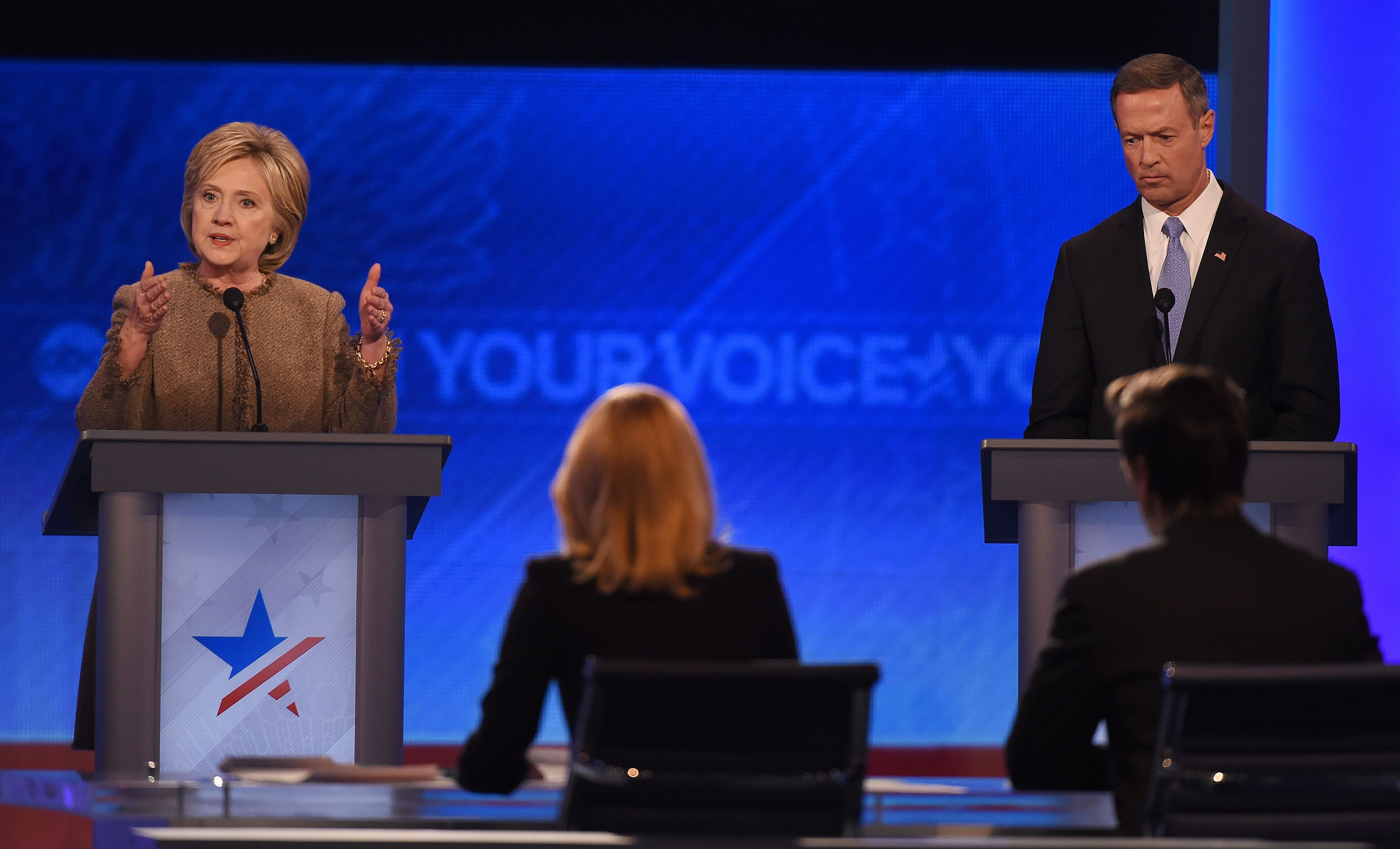 Hillary Clinton, left, speaks as fellow candidate Martin O'Malley listens during the Democratic Presidential Debate hosted by ABC News at Saint Anselm College in Manchester, New Hampshire, on Dec. 19, 2015.