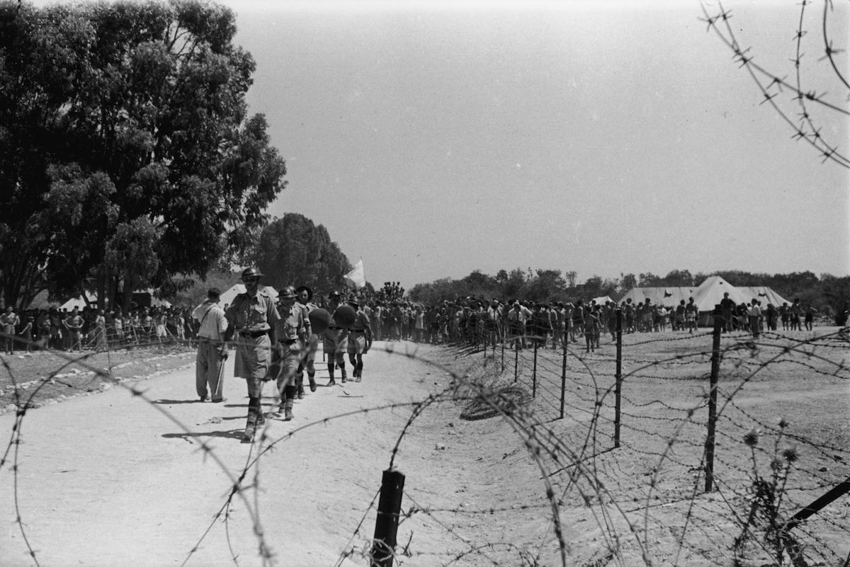September 1946:  British troops and Jewish immigrants at the camp near Famagusta, Cyprus, where Jewish refugees are being kept, having been turned away from Palestine.
