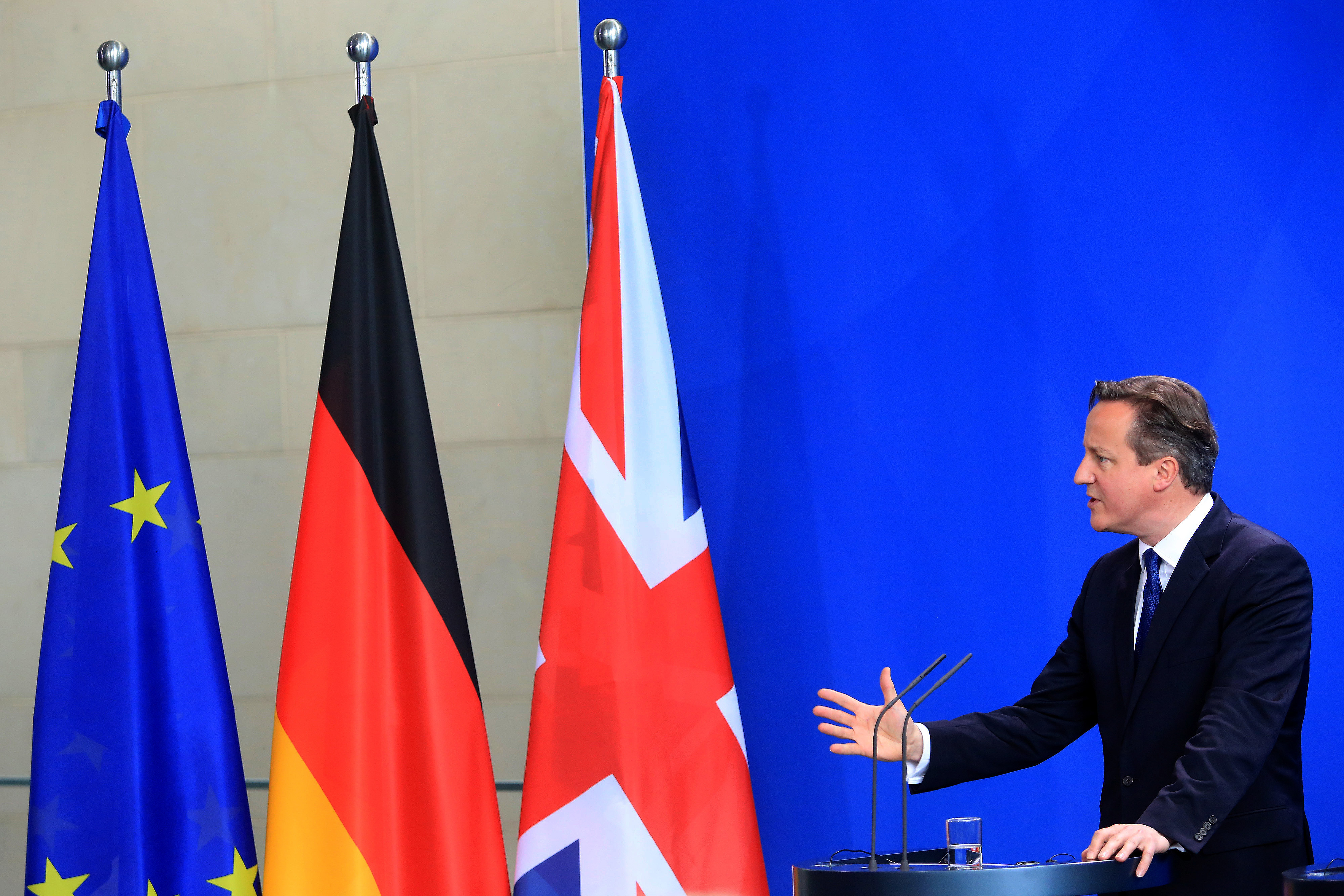 David Cameron, U.K. prime minister, gestures as he speaks during a news conference at the Chancellery in Berlin, Germany, on Friday, May 29, 2015. Chancellor Angela Merkel offered to help Cameron secure the changes he wants to Britain's relationship with the European Union, including the possibility of changing EU treaties if necessary