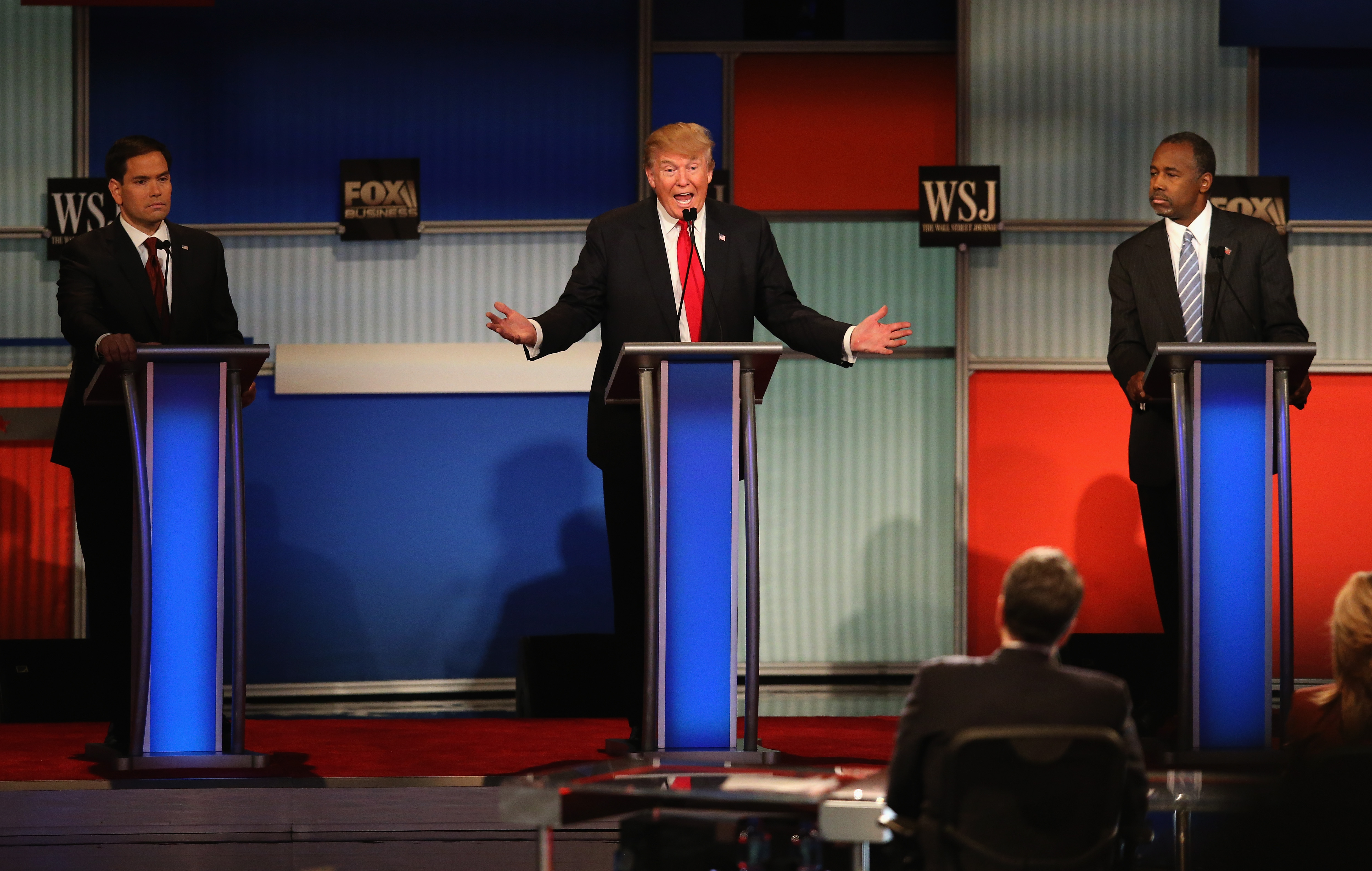 Presidential candidate Donald Trump (C) speaks while Sen. Marco Rubio (L) (R-FL), and Ben Carson look on during the Republican Presidential Debate sponsored by Fox Business and the Wall Street Journal in Milwaukee, Wisc., on Nov. 10, 2015.