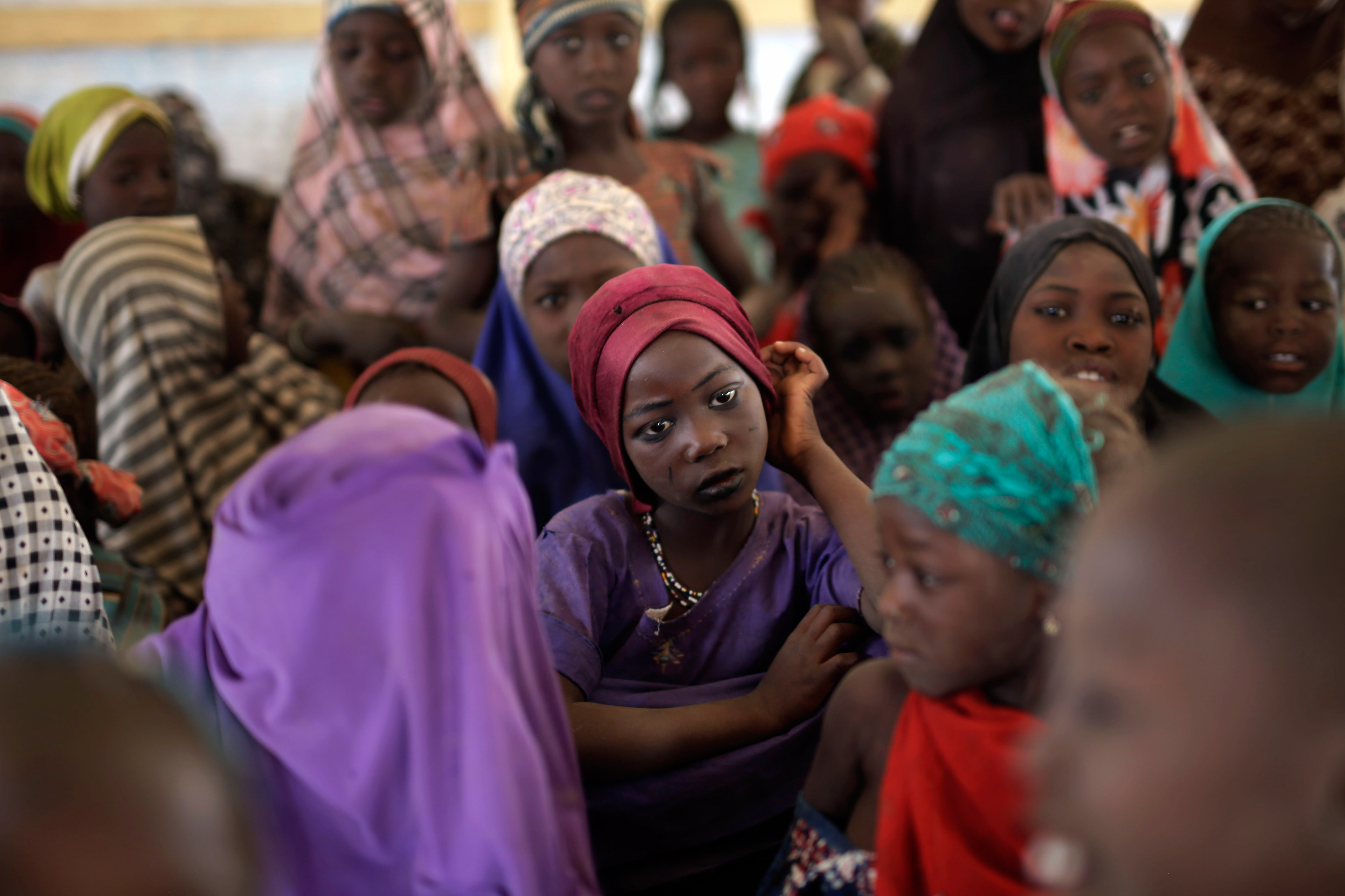 Nigerian girls who fled Boko Haram to Chad gather in a school set up by UNICEF at the Baga Solo refugee camp in Chad on March 4, 2015.