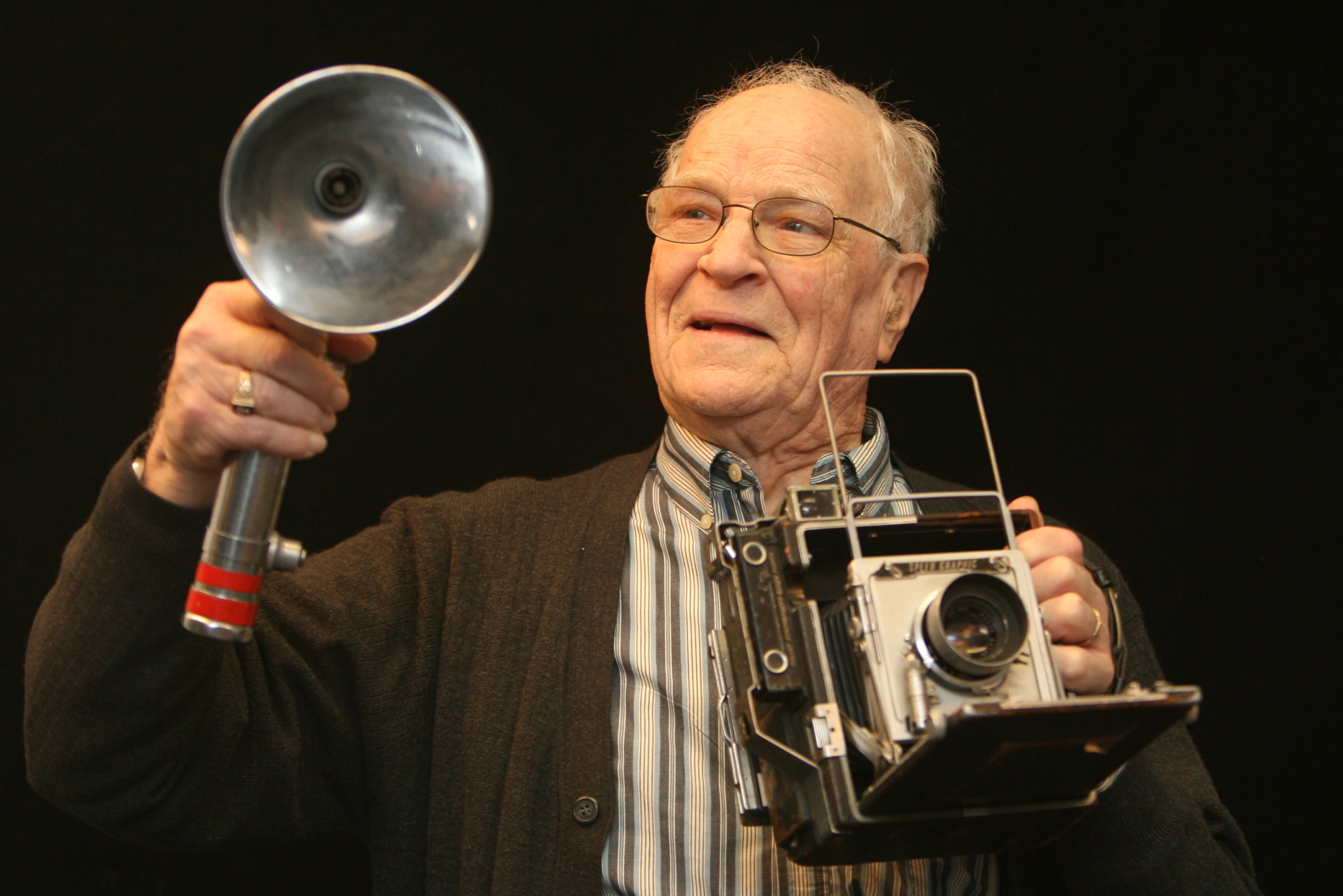 Elwin Musser displays the gear he used as a Globe Gazette photographer.