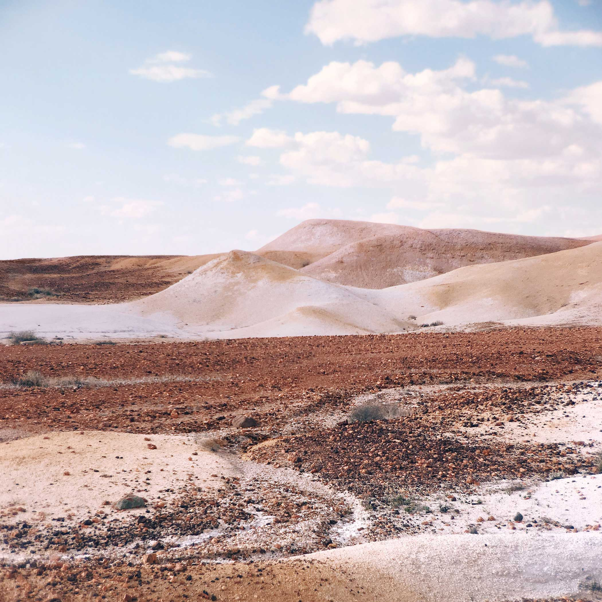 To create Songlines, Emma Phillips explores the Australian desert until she finds a striking view. Then she uses an iPhone 6s to shoot the scene with an Olloclip Active Lens.