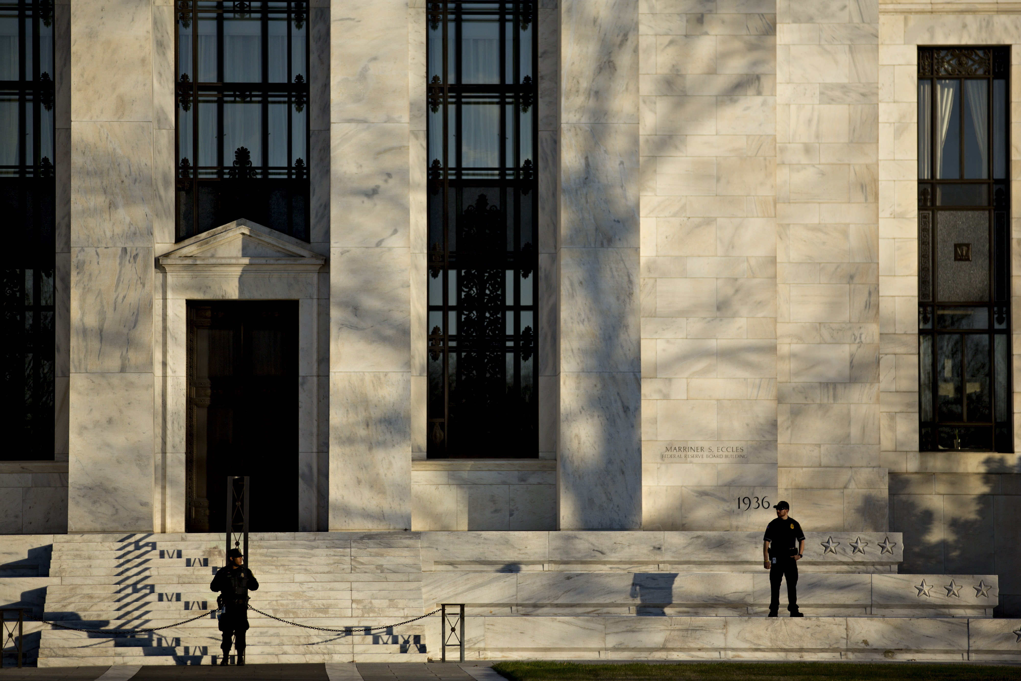 Federal Reserve police officers stand in front of the Marriner S. Eccles Federal Reserve building in Washington, D.C., on Dec. 15, 2015.