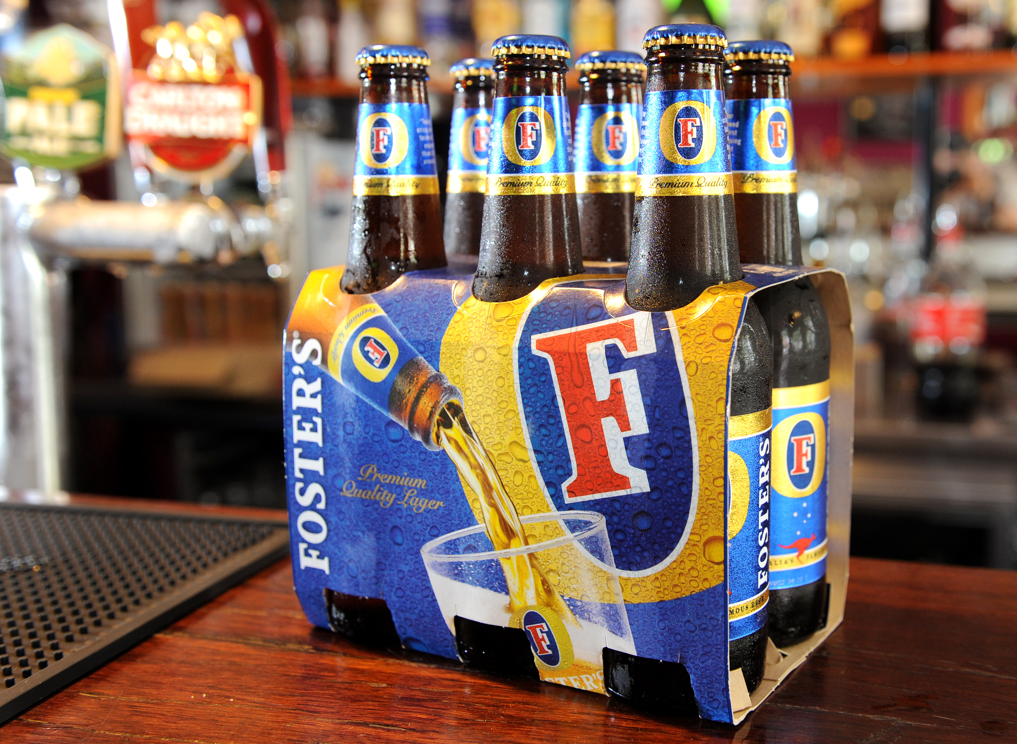 Bottles of Foster's beer sits on the bar at the Drop Bear Inn in South Melbourne on November 25, 2011.