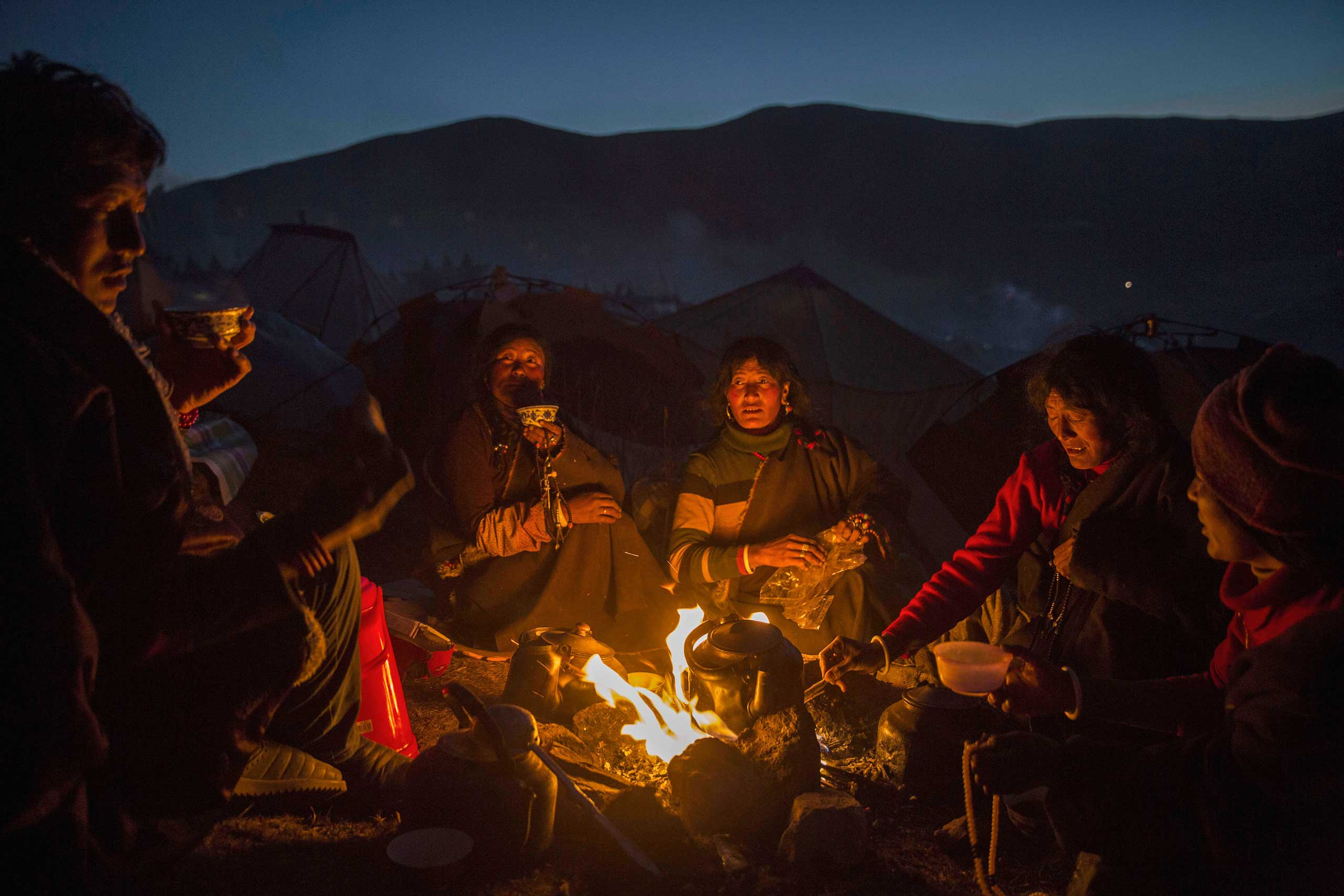 NBC News: Buddhists Search for Bliss in Remote Tibetan PlateauTibetan Buddhist nomads cook and stay warm by candlelight at dusk following a chanting session as part of the annual Bliss Dharma Assembly at the Larung Wuming Buddhist Institute in Sertar county, in the remote Garze Tibetan Autonomous Prefecture, Sichuan province, China,  on Oct. 31, 2015.