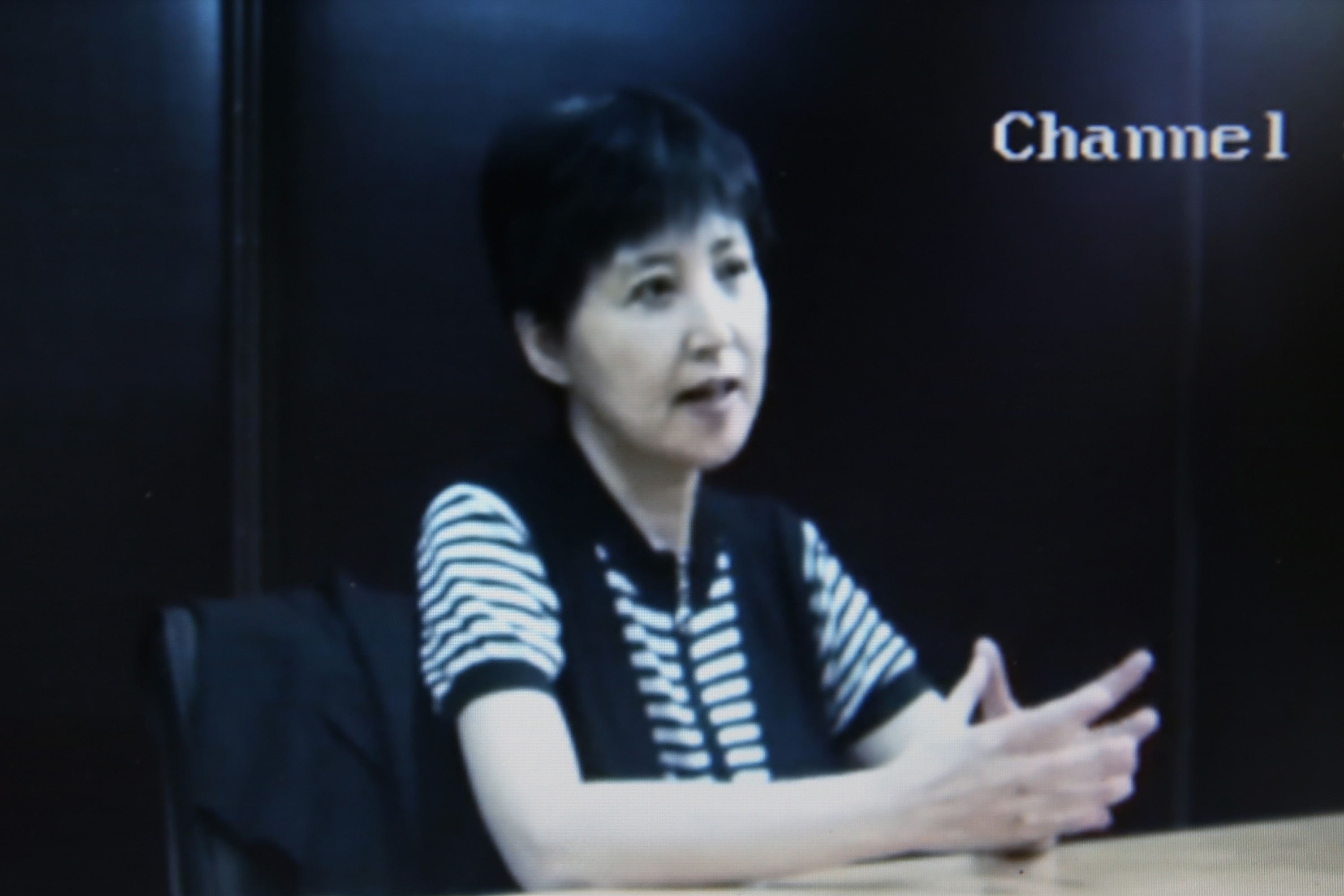 A screen grab shows a video of Gu Kailai, wife of ousted Chinese Communist Party Politburo member Bo Xilai, at the media room for Bo's trial on Aug. 23, 2013, in Jinan, China