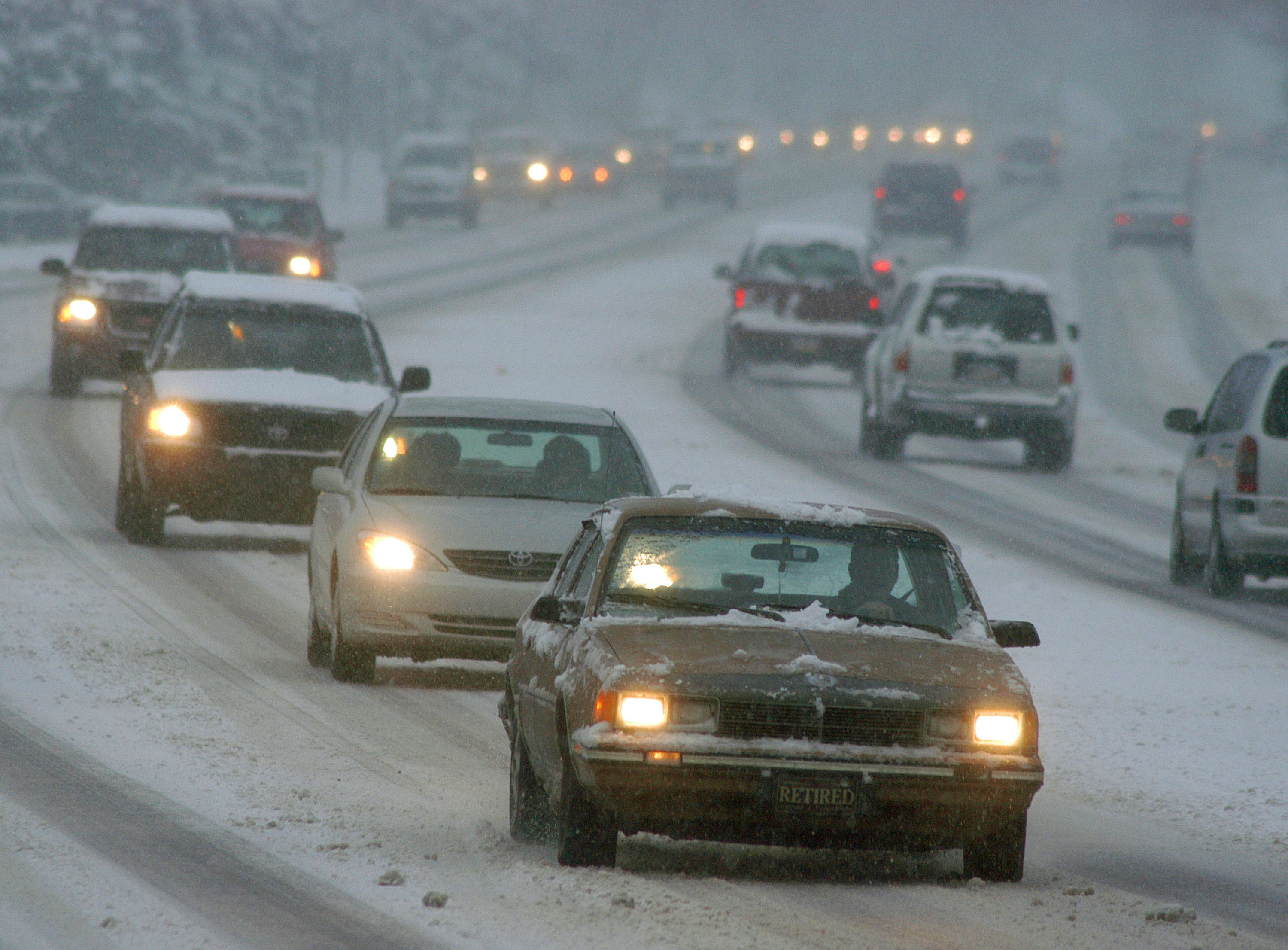 Drivers slowly navigate an icy Route 611 December 5, 2003 in Warrington, Pennsylvania.