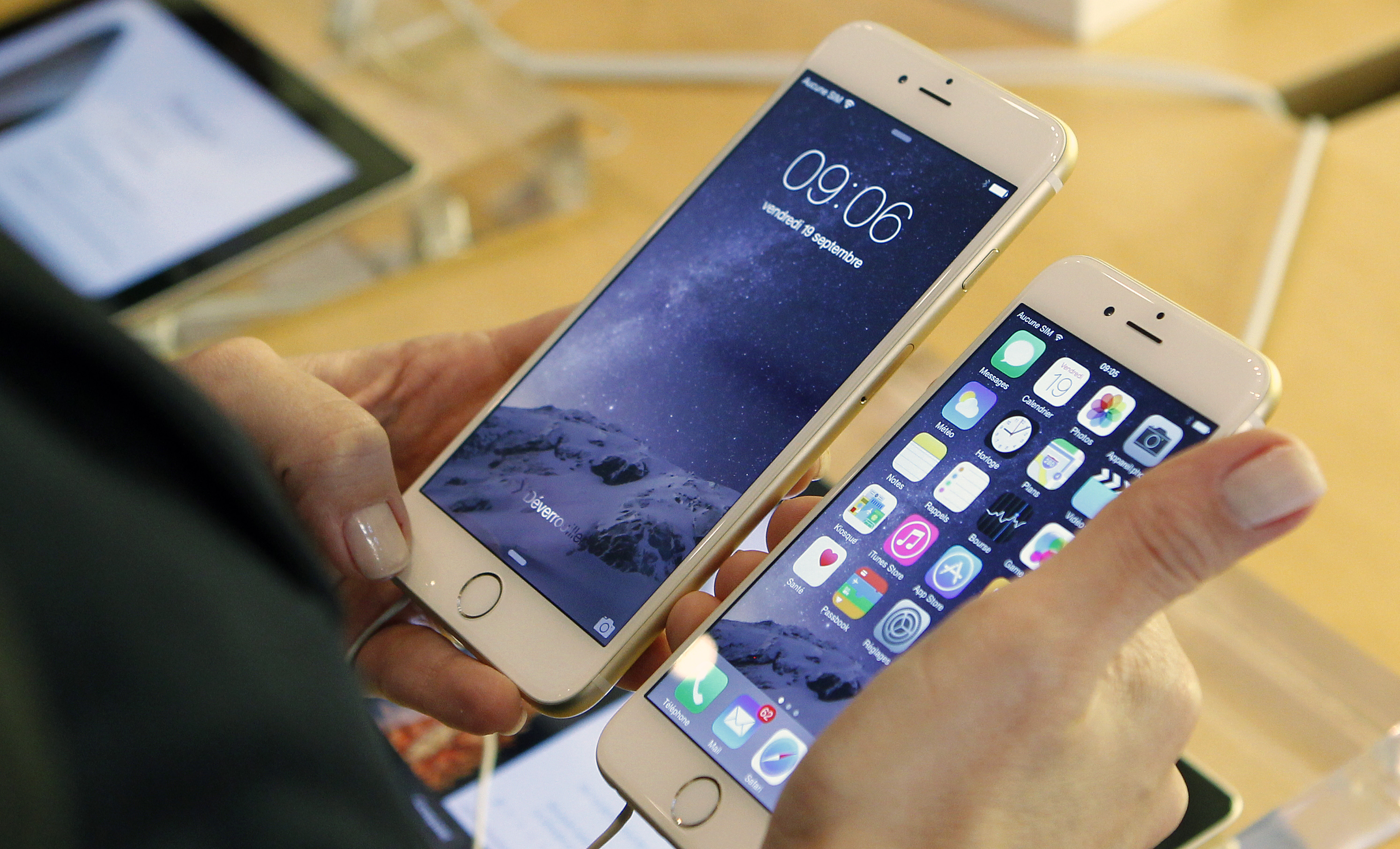 A Woman checks the iPhone 6, on the day of its launch at the Apple Store Opera on September 19, 2014, in Paris, France.