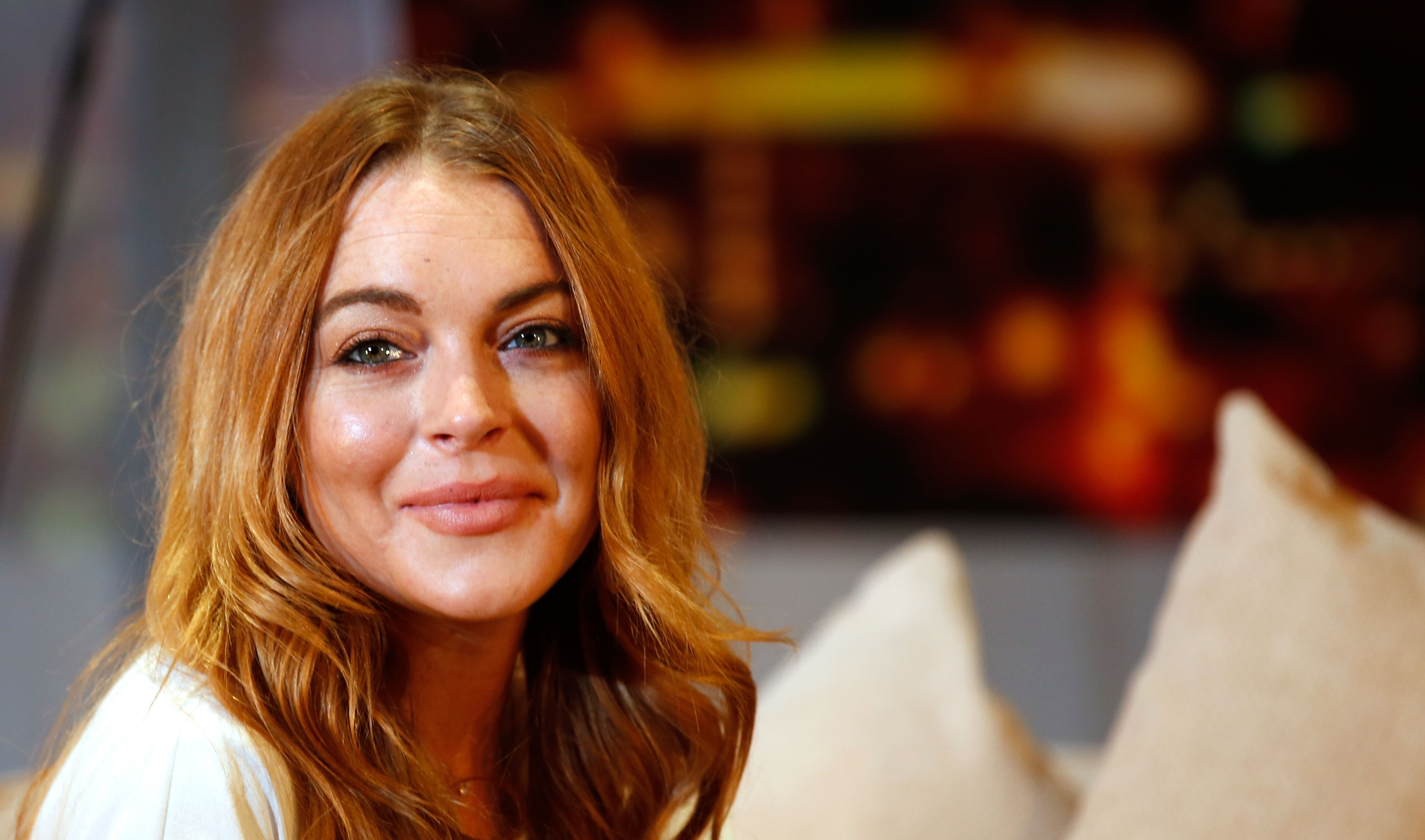 Lindsay Lohan performs during a photocall for  Speed The Plow  at Playhouse Theatre on September 30, 2014 in London, England.