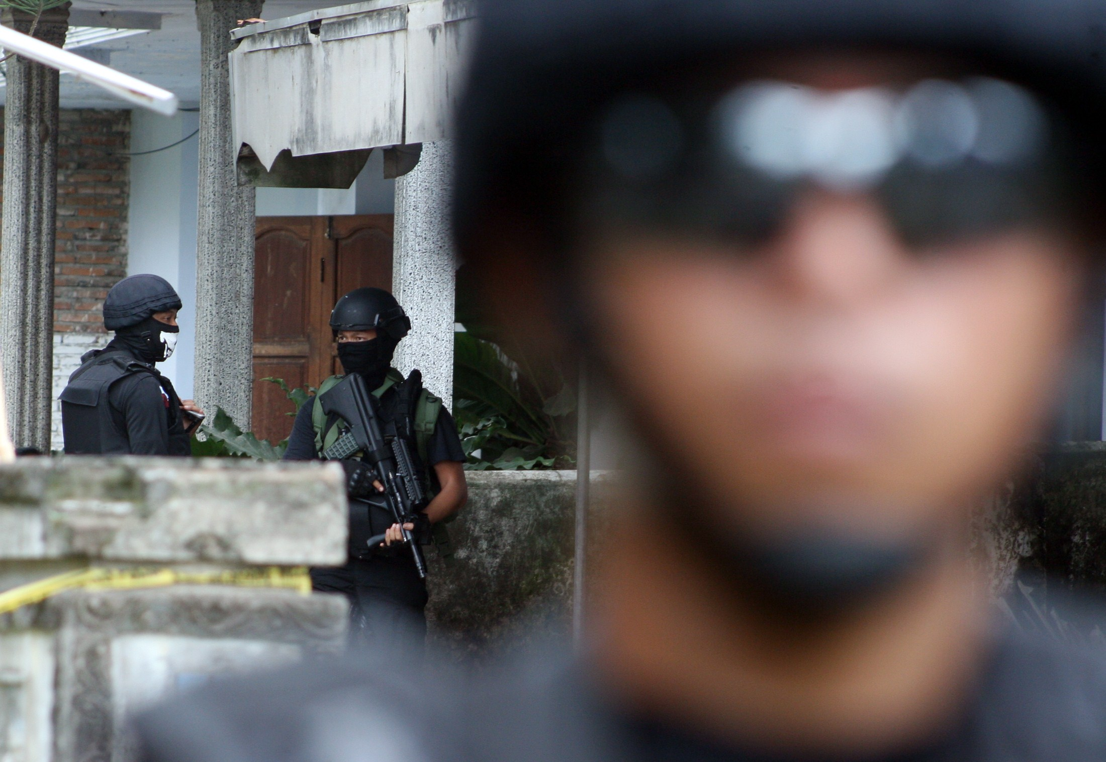 Indonesian antiterrorism police squad Densus 88 search houses in the Indonesian town of Kediri, in eastern Java, on Jan. 16, 2015