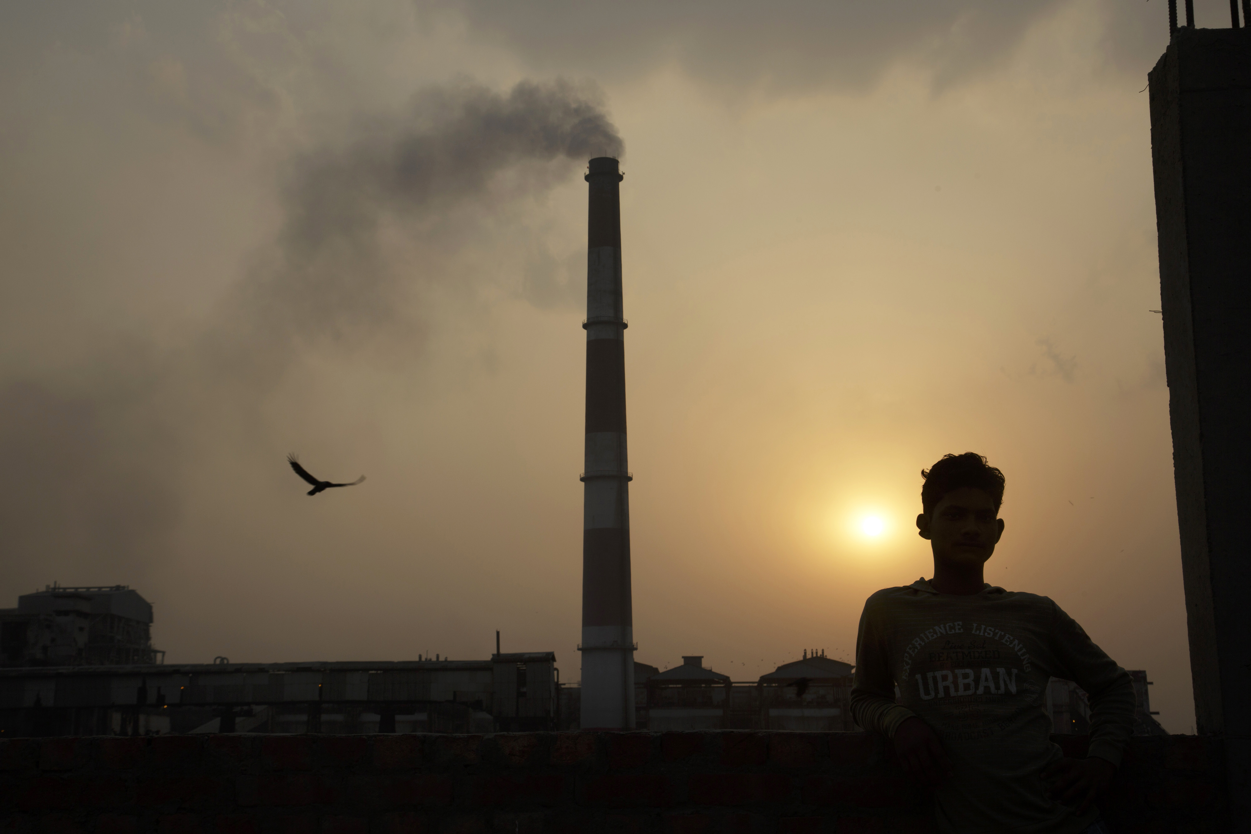 Emissions billow from smokestacks at the NTPC Ltd. Badarpur coal-fired power plant as the sun sets in Badarpur, Delhi, India, on Tuesday, April 28, 2015.