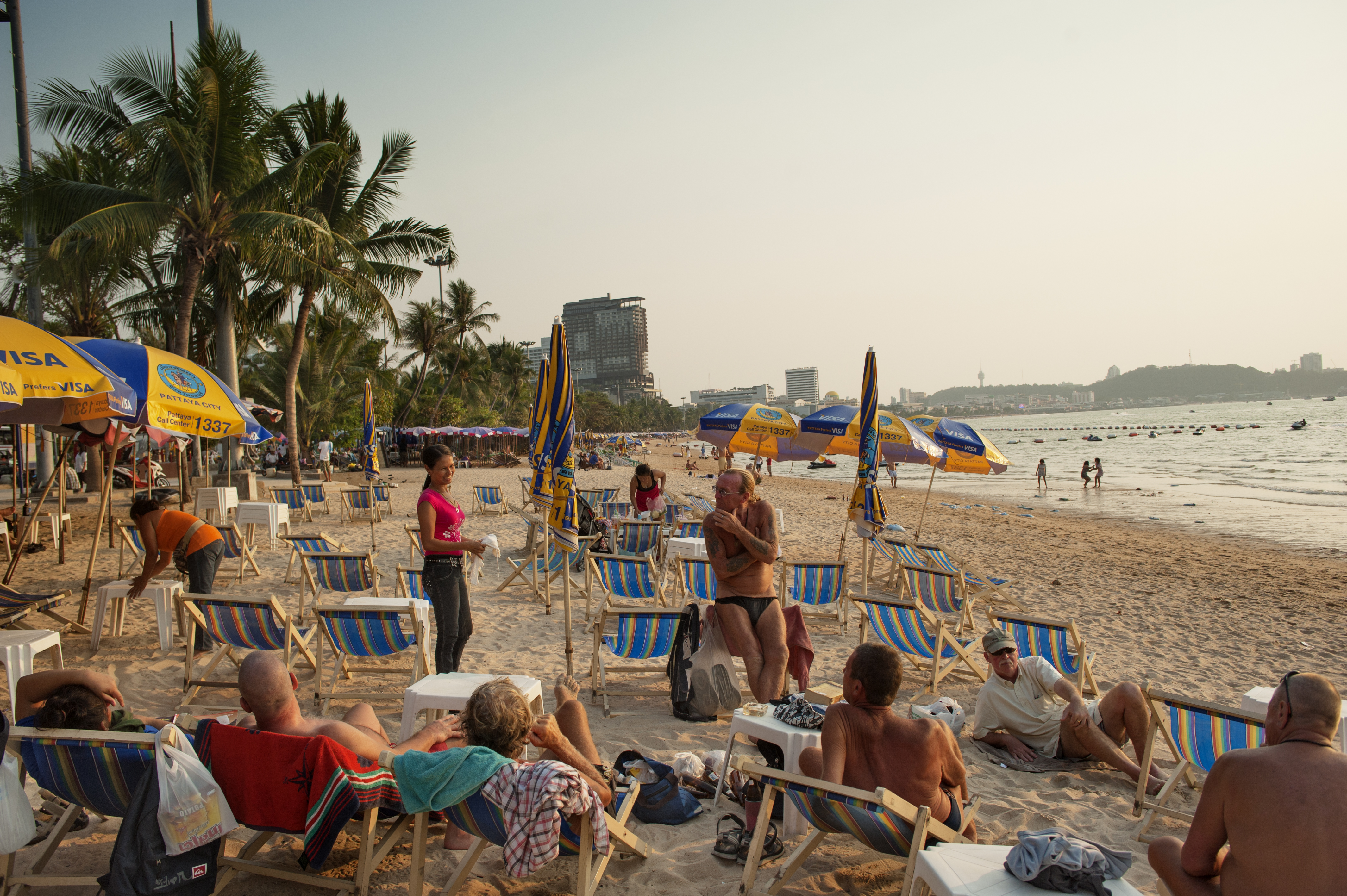Tourists enjoy the beach at Pattaya in this file photo from 2013. The city remains a popular destination, drawing throngs of travelers throughout the year