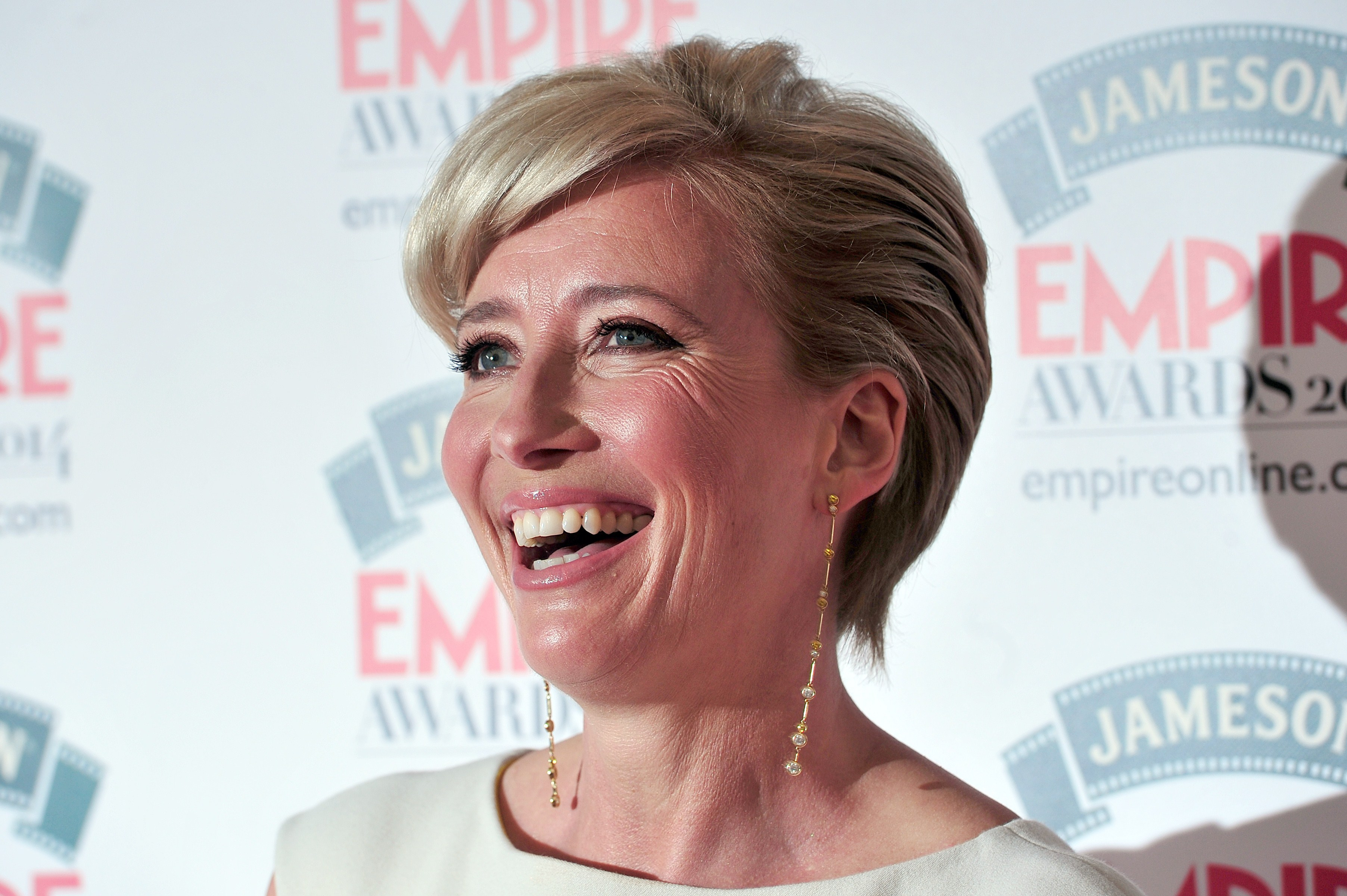 British actress Emma Thompson poses for pictures as she arrives for the 2014 Empire Awards in central London on March 30, 2014.