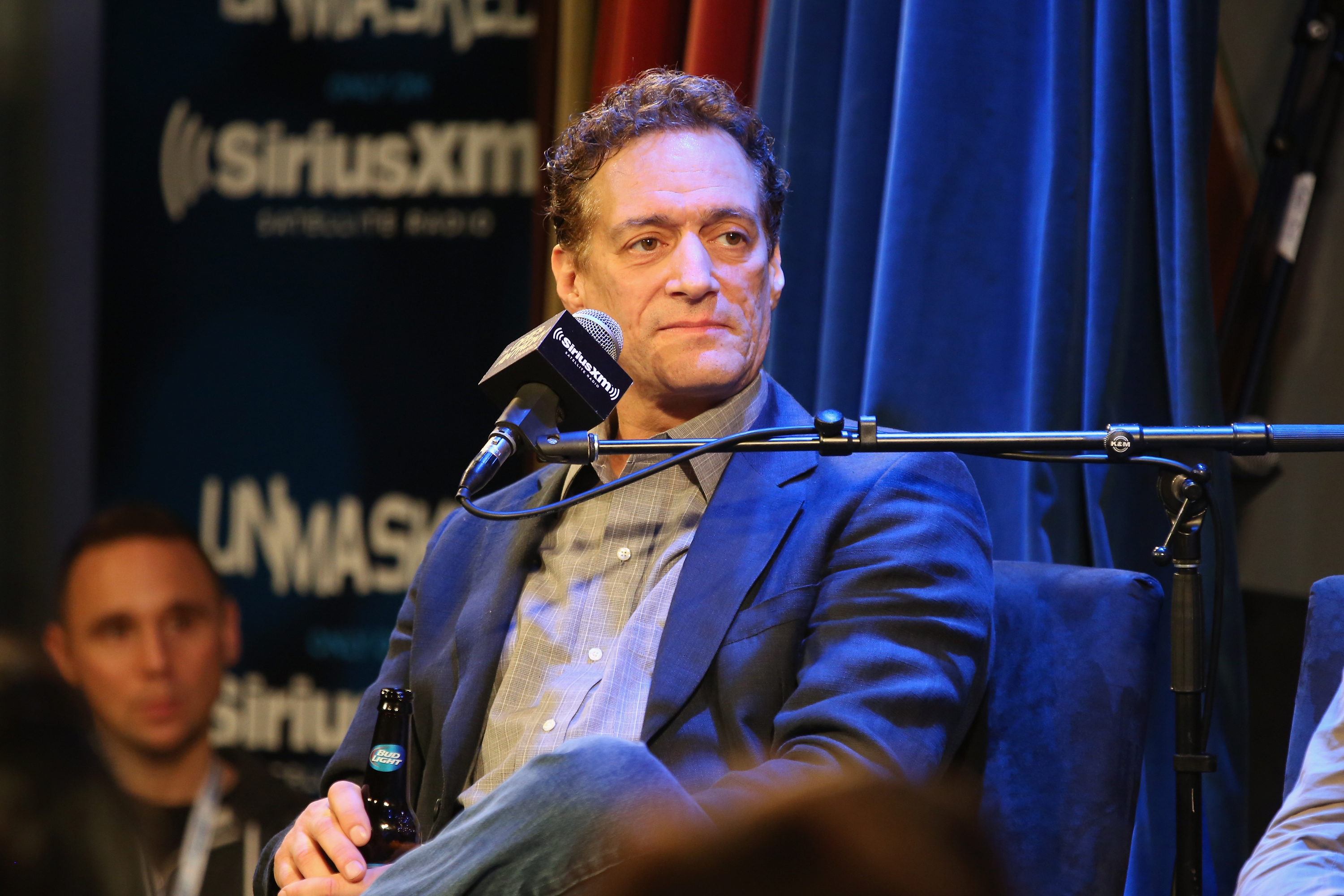 Anthony Cumia, 54, is accused of assaulting a 26-year-old woman in his New York home, police said.
