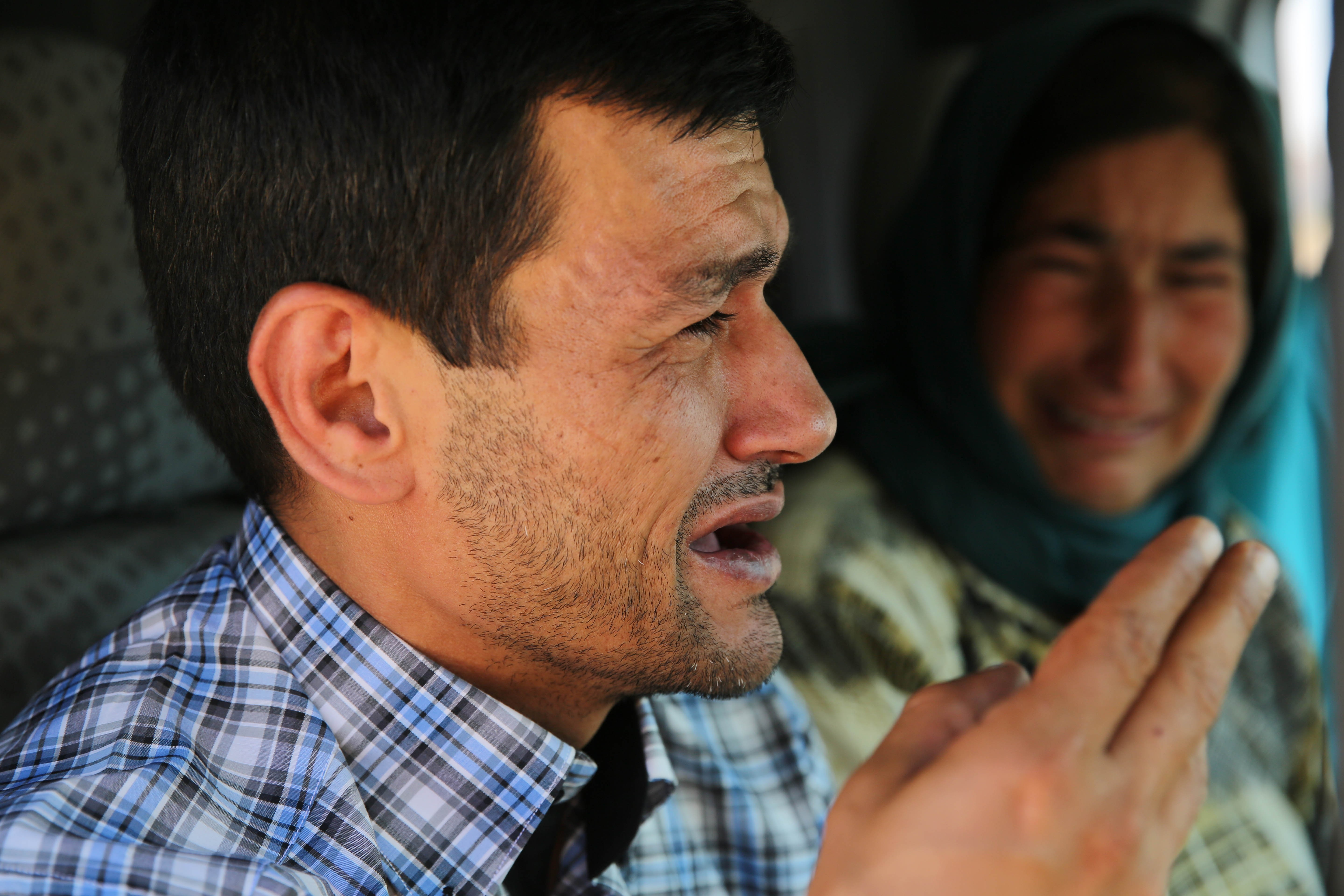 Abdullah Kurdi, father of Syrian children Aylan, 2, his brother Galip, 3, and husband of Zahin Kurdi, 27, who drowned after their boat sank en route to the Greek islands in the Aegean Sea, cries on his way to the Syrian border town of Kobani (Ayn al-Arab) to hold funeral of his family on September 4, 2015. The 12 people, including eight children, drowned after their boat sank en route to the Greek islands in the Aegean Sea.