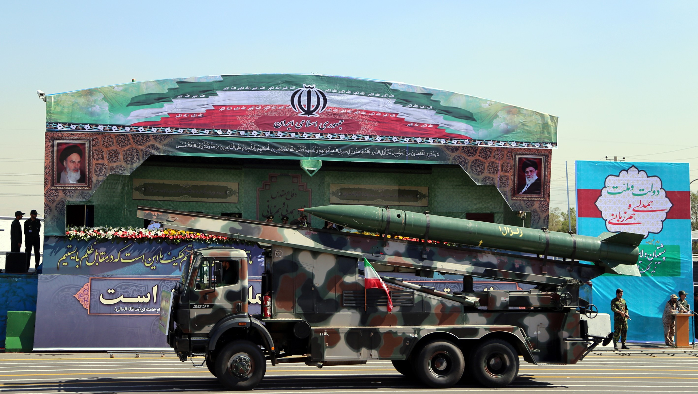 A vehicle carrying a missile system is driven past Iranian military commanders during an annual military parade, on Sept. 22, 2015, in the capital Tehran
