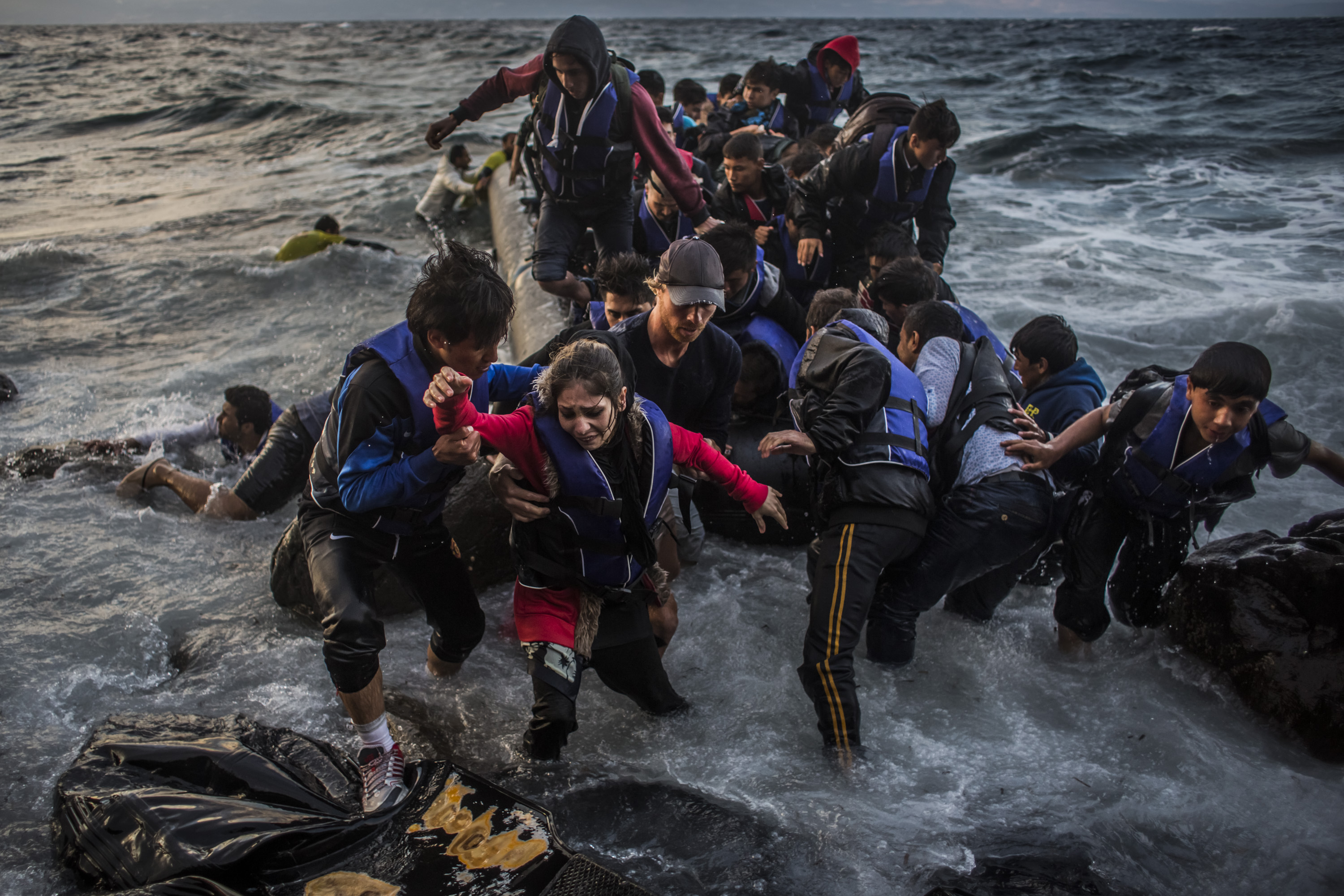 Refugees arrive on the shores of the Greek island of Lesbos, near Skala Sikaminias village, Greece, on Oct. 1, 2015, after crossing the Aegean Sea from Turkey on an inflatable boat