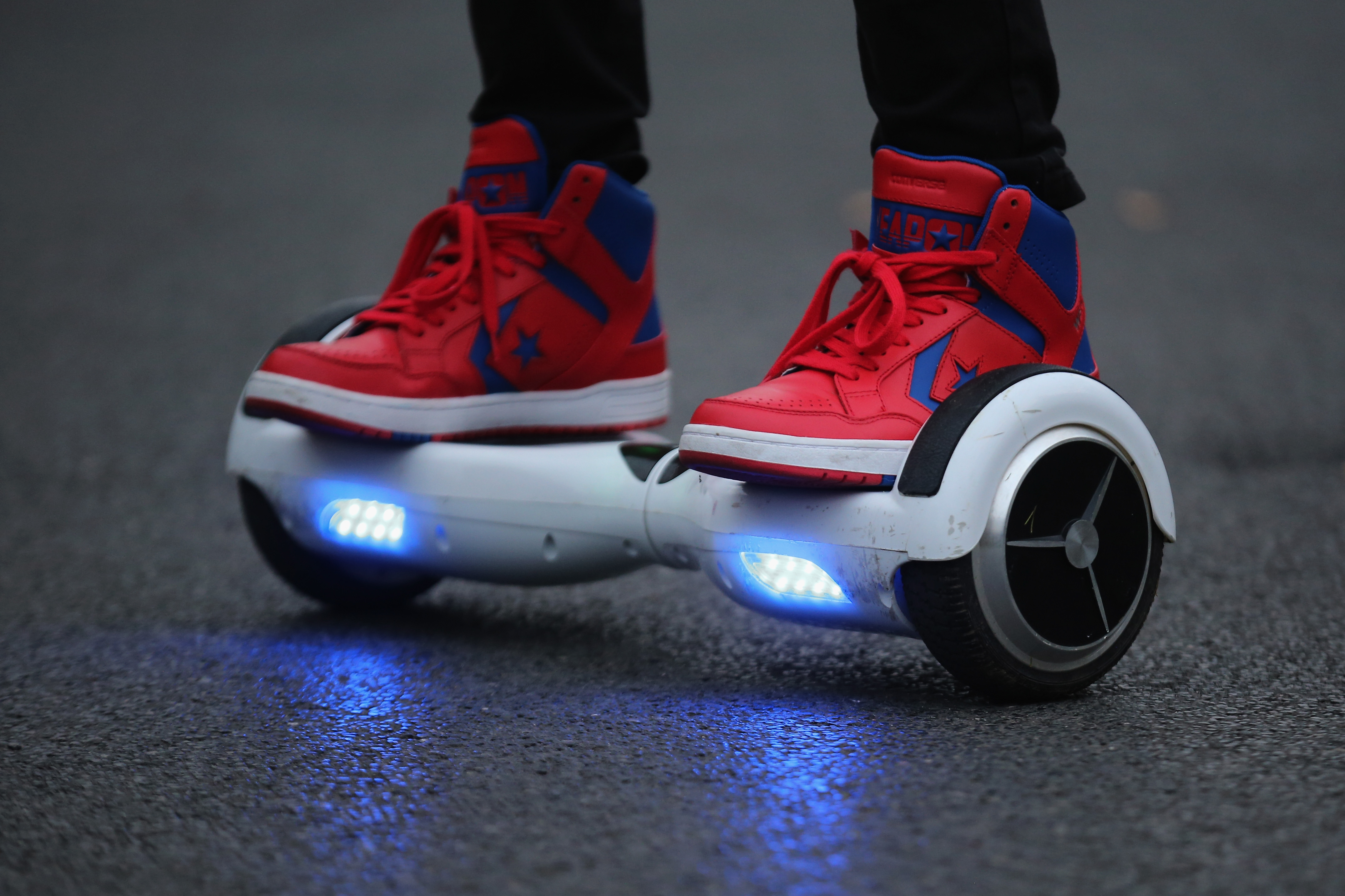 A youth poses as he rides a hoverboard, which are also known as self-balancing scooters and balance boards, on October 13, 2015 in Knutsford, England.