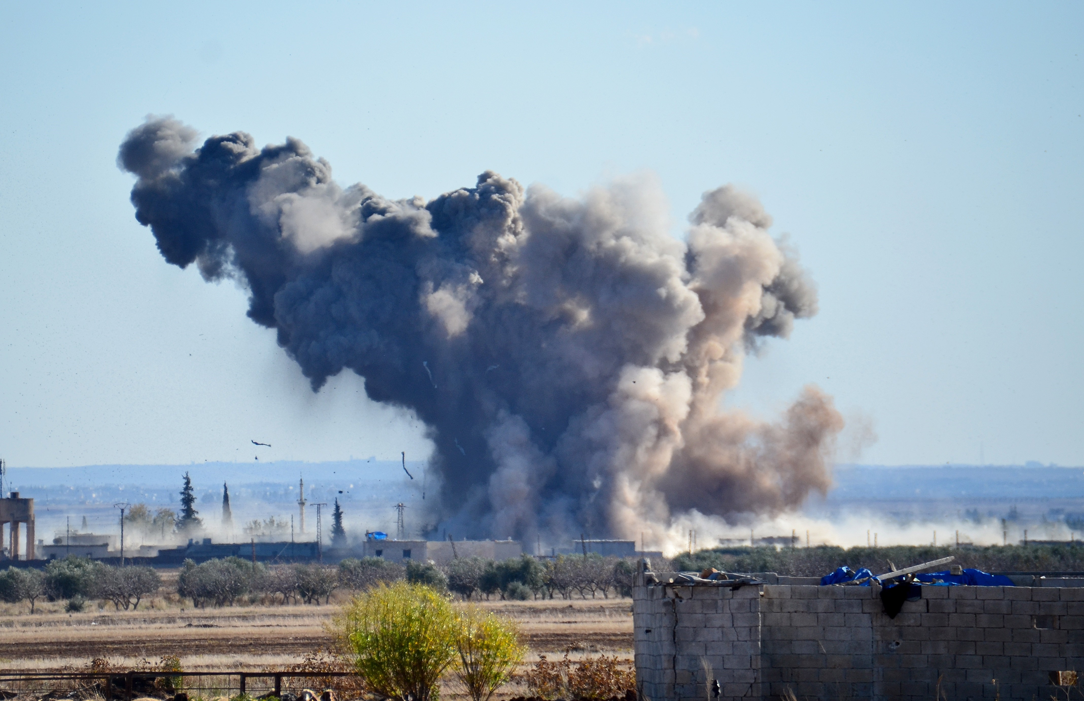 Smoke rises after the U.S.-led coalition air strikes hit ISIS positions at Brekida village in Aleppo, Syria, on Dec. 3, 2015