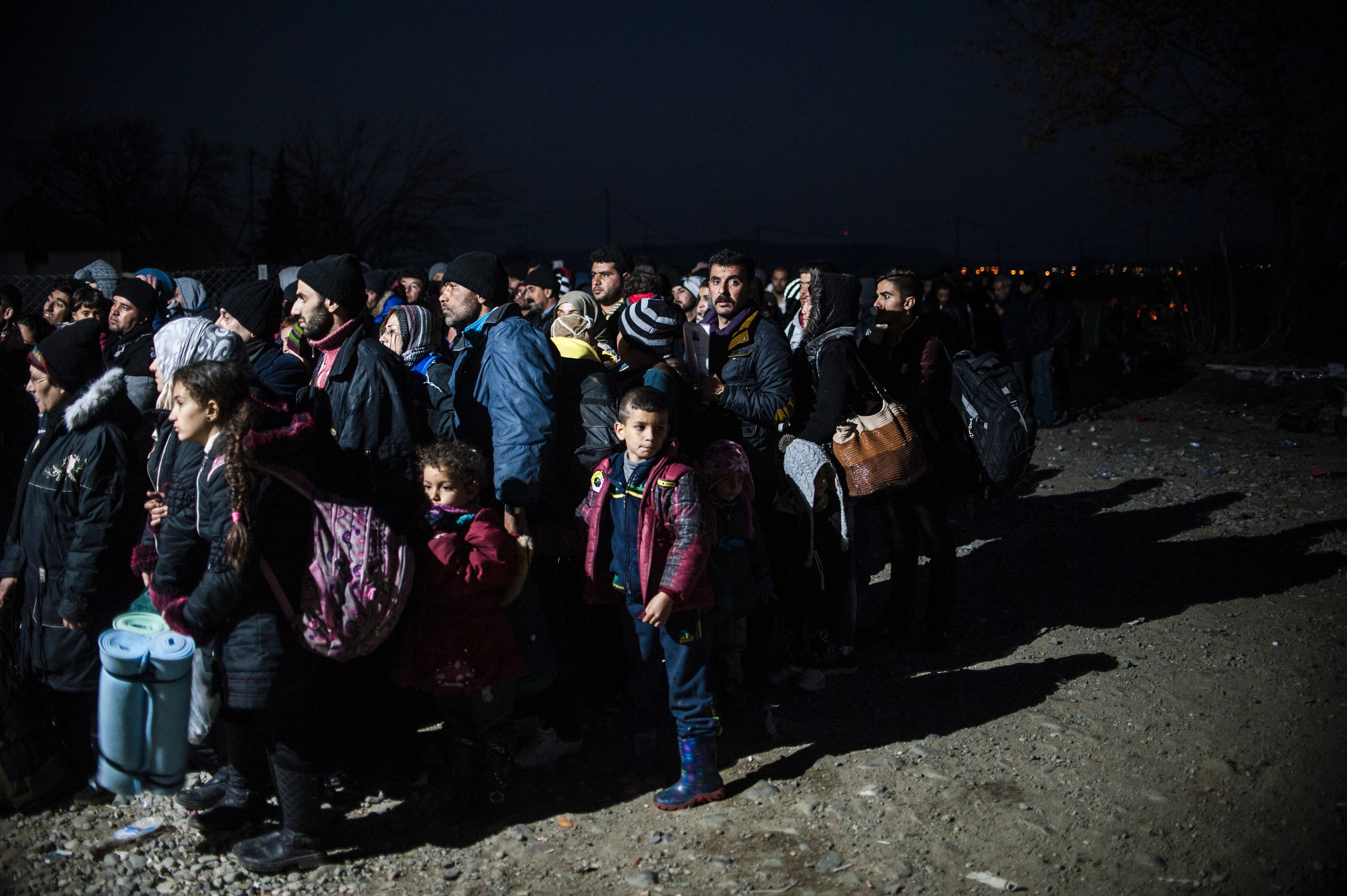 Migrants wait to enter a refugee camp after crossing the Greek-Macedonian border, near Gevgelija, Macedonia, on Dec. 5, 2015