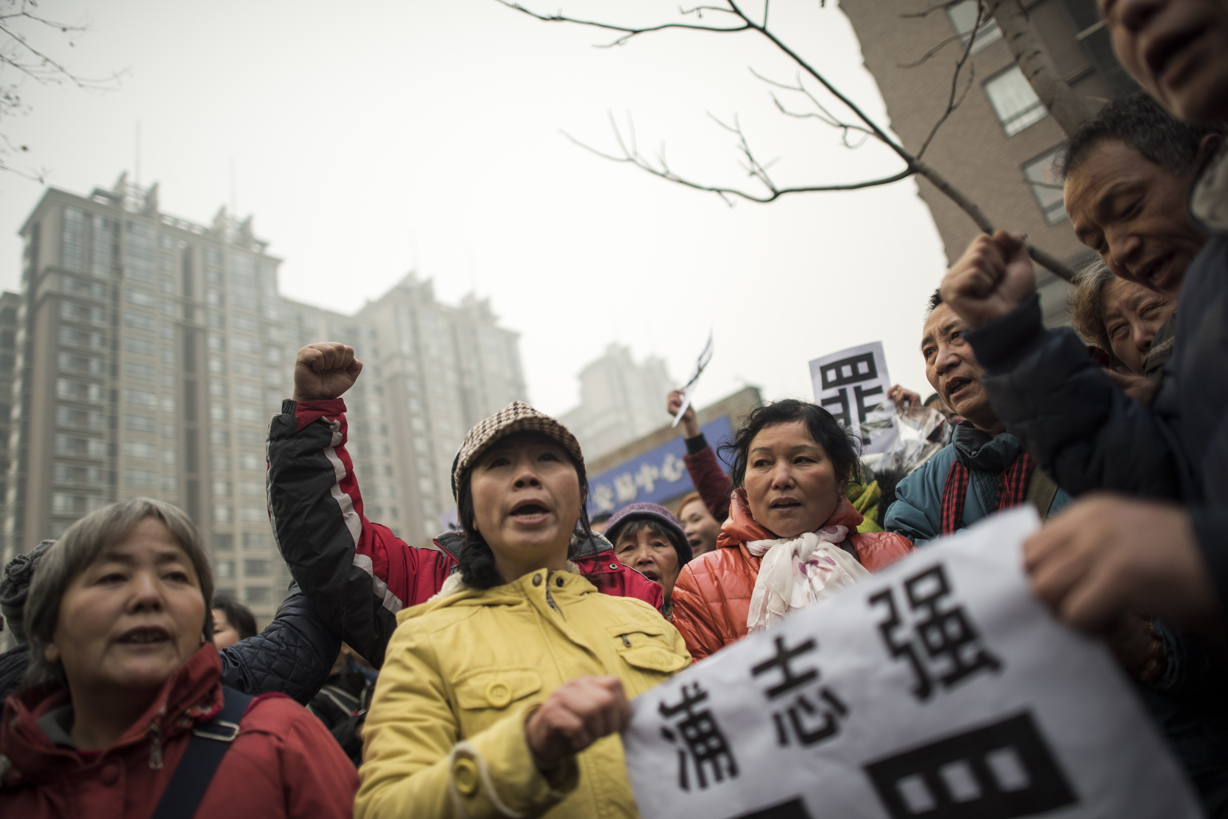 Supporters of human-rights lawyer Pu Zhiqiang hold a placard that reads  Pu Zhiqiang, Innocent  during a demonstration near the Beijing No. 2 Intermediate People's Court in Beijing on Dec. 14, 2015