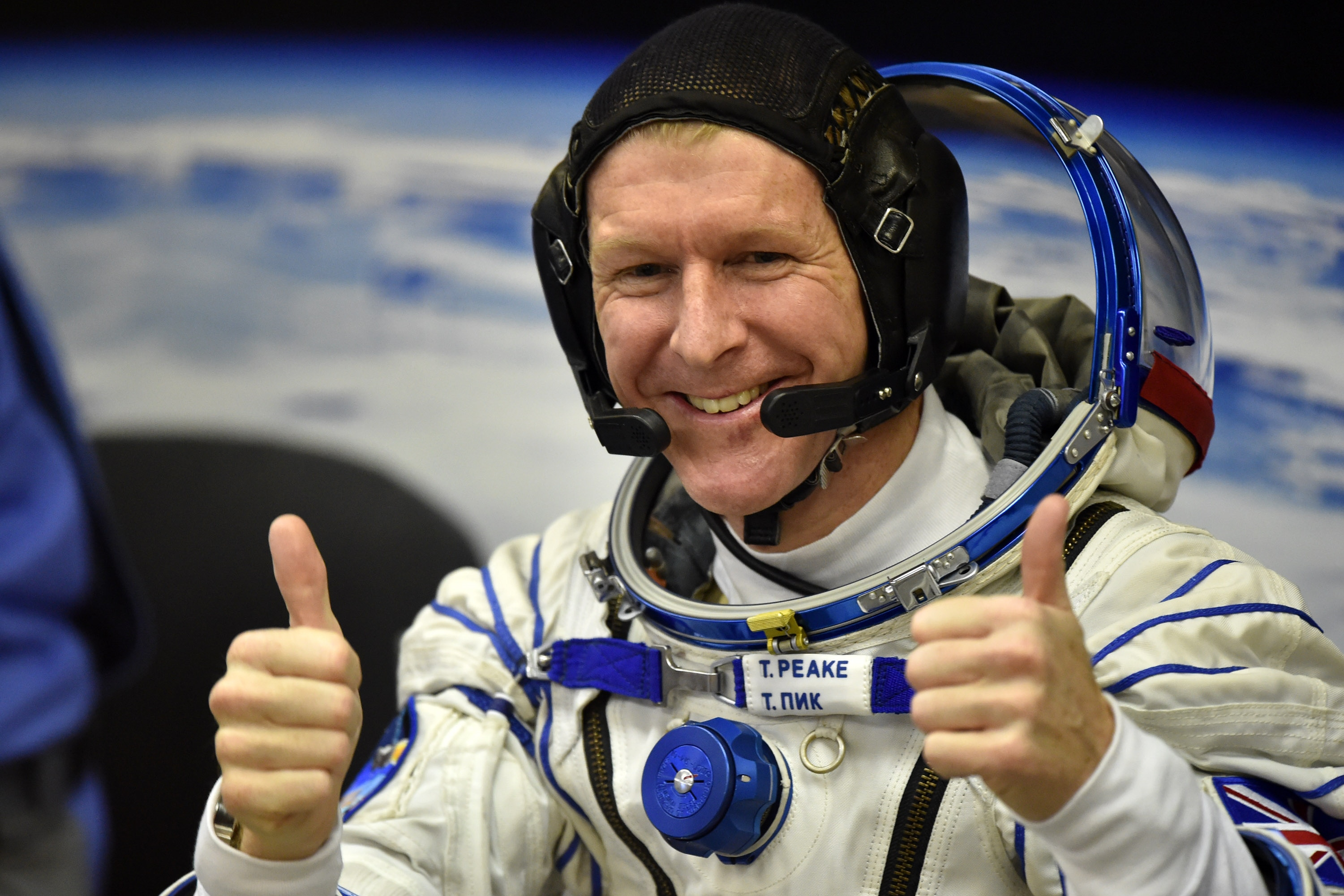 Britain's astronaut Tim Peake gestures as his space suit is tested at the Russian-leased Baikonur cosmodrome, prior to blasting off to the International Space Station (ISS), on Dec. 15, 2015.