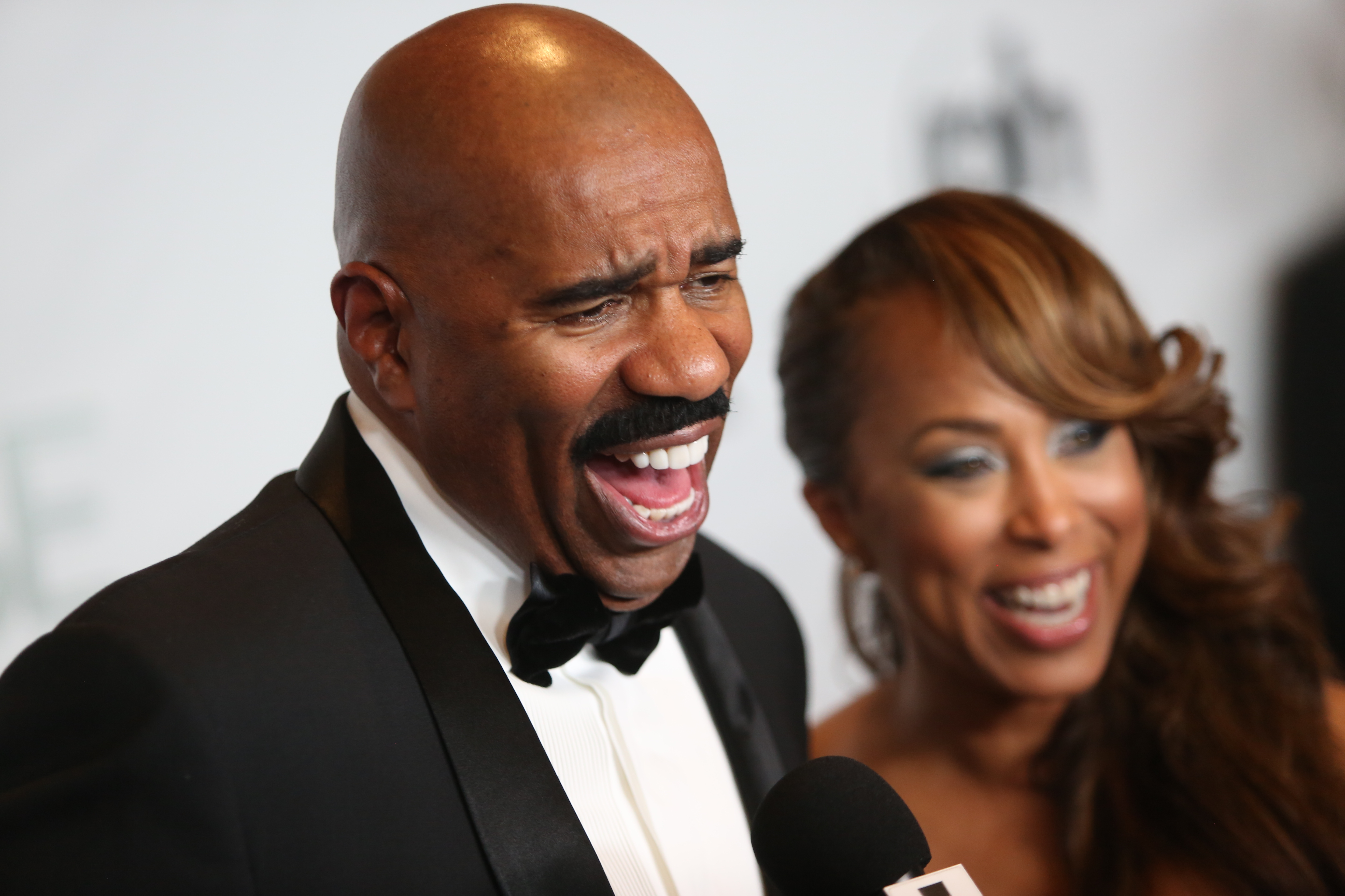 Steve Harvey talks with a journalist during the The 64th Annual Miss Universe Pageant Arrivals on Dec. 20, 2015 in Las Vegas.
