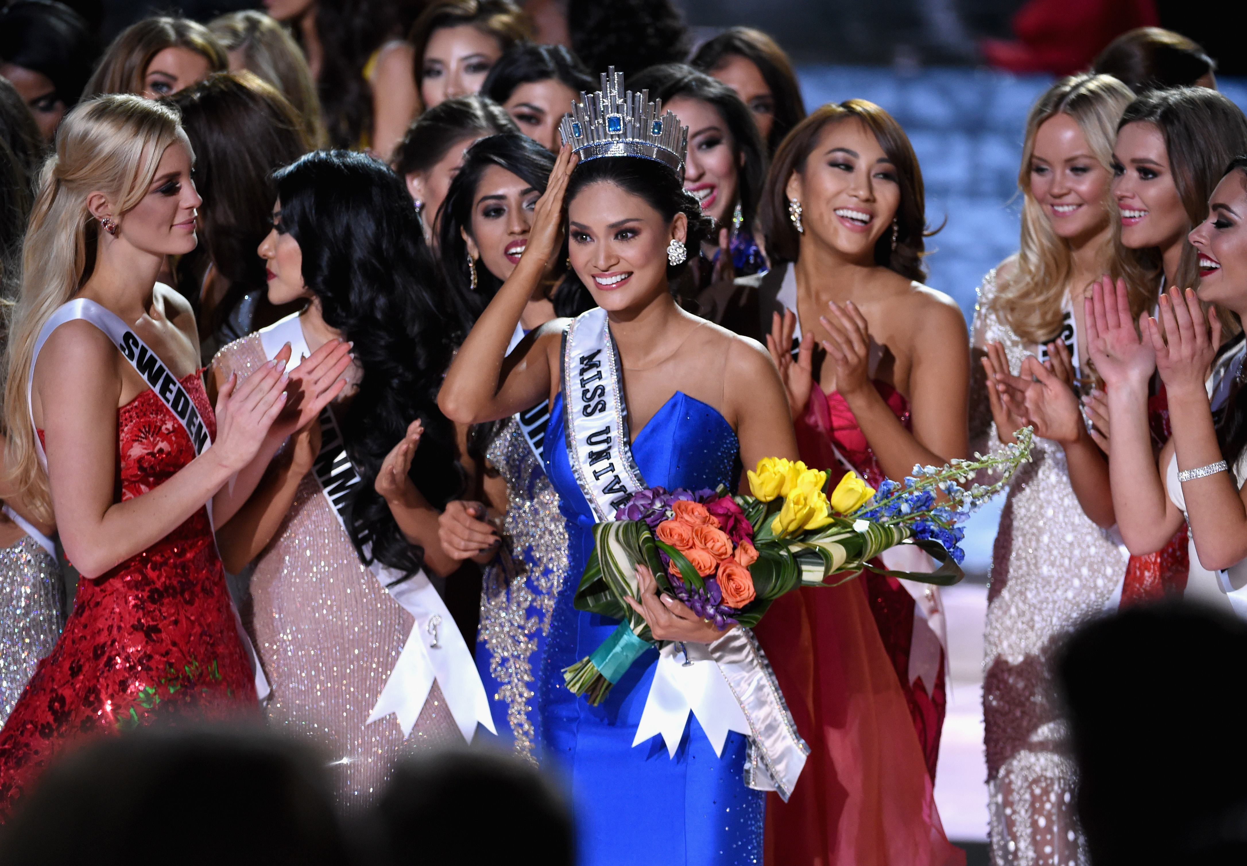 Miss Philippines 2015, Pia Alonzo Wurtzbach, who was mistakenly named as First Runner-up, reacts with other contestants after being named the 2015 Miss Universe during the 2015 Miss Universe Pageant on Dec. 20, 2015 in Las Vegas.