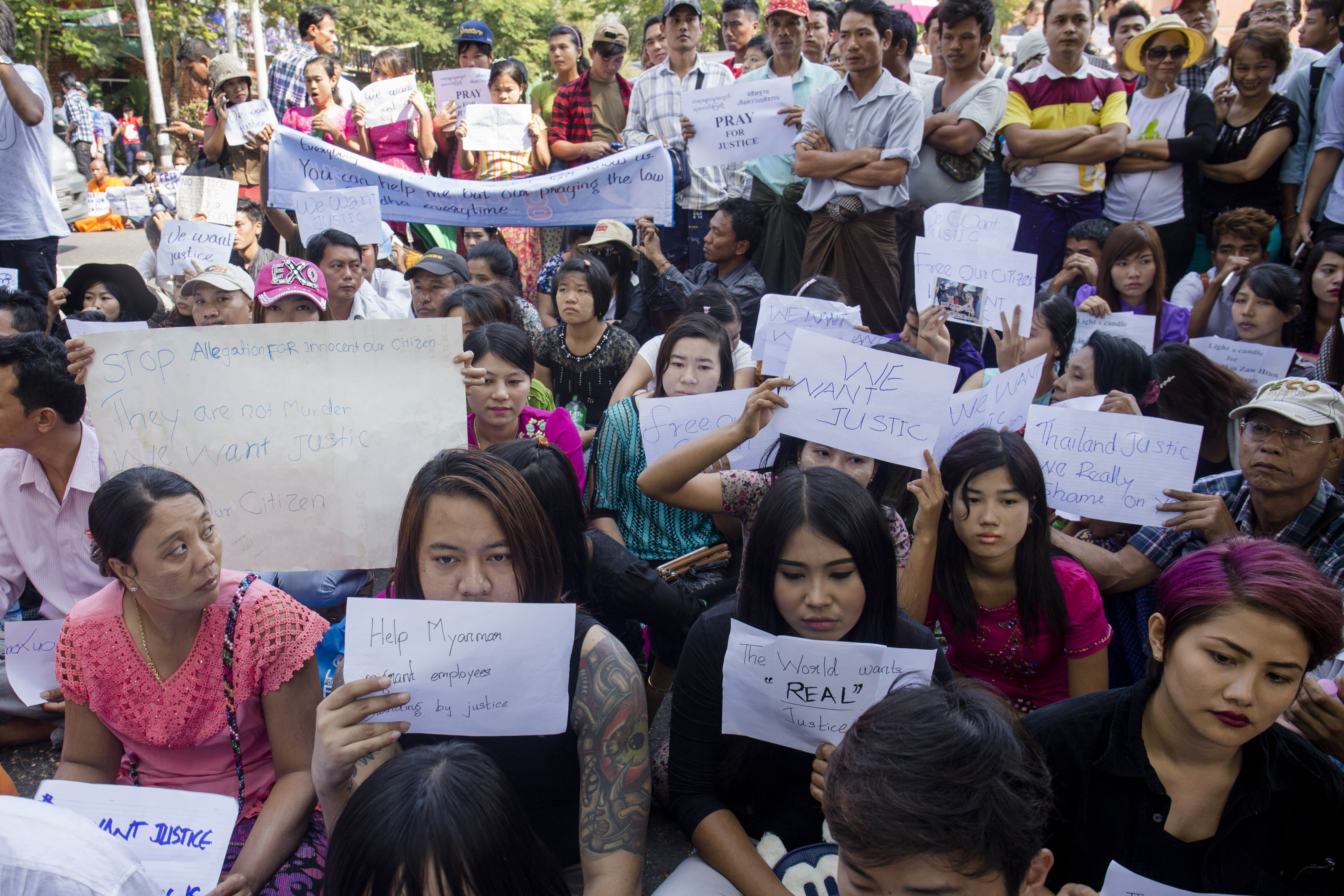 Demonstrators hold placards outside the Thai embassy in Rangoon on Dec. 26, 2015, to protest the death sentence of Burmese migrant workers Zaw Lin and Wai Phyo by a Thai court