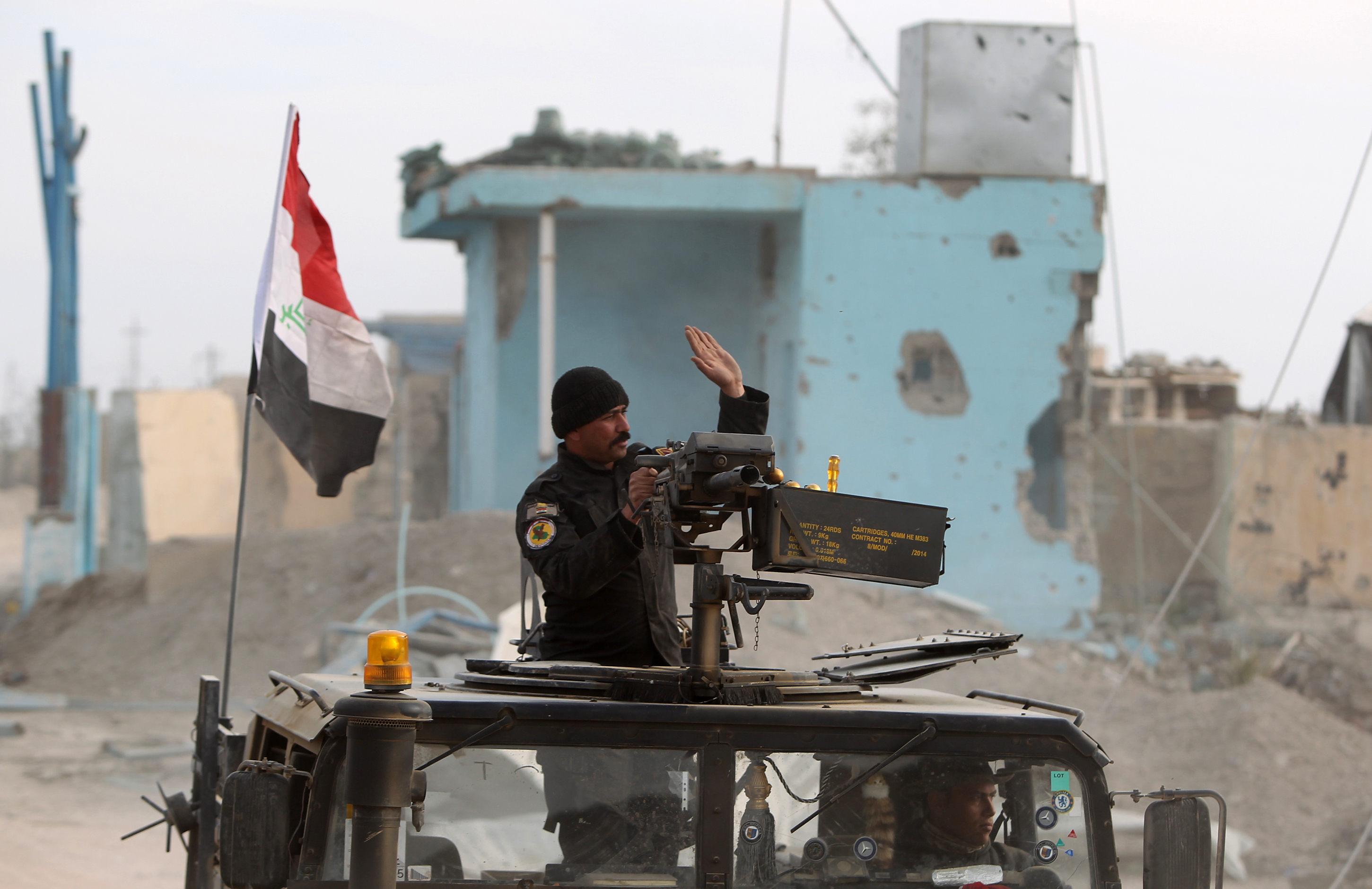 Members of Iraq's elite counterterrorism service secure on Dec. 27, 2015, the Hoz neighborhood in central Ramadi, the capital of Iraq's Anbar province, about 110 km west of Baghdad, during military operations conducted by Iraqi pro-government forces against the jihadist group ISIS
