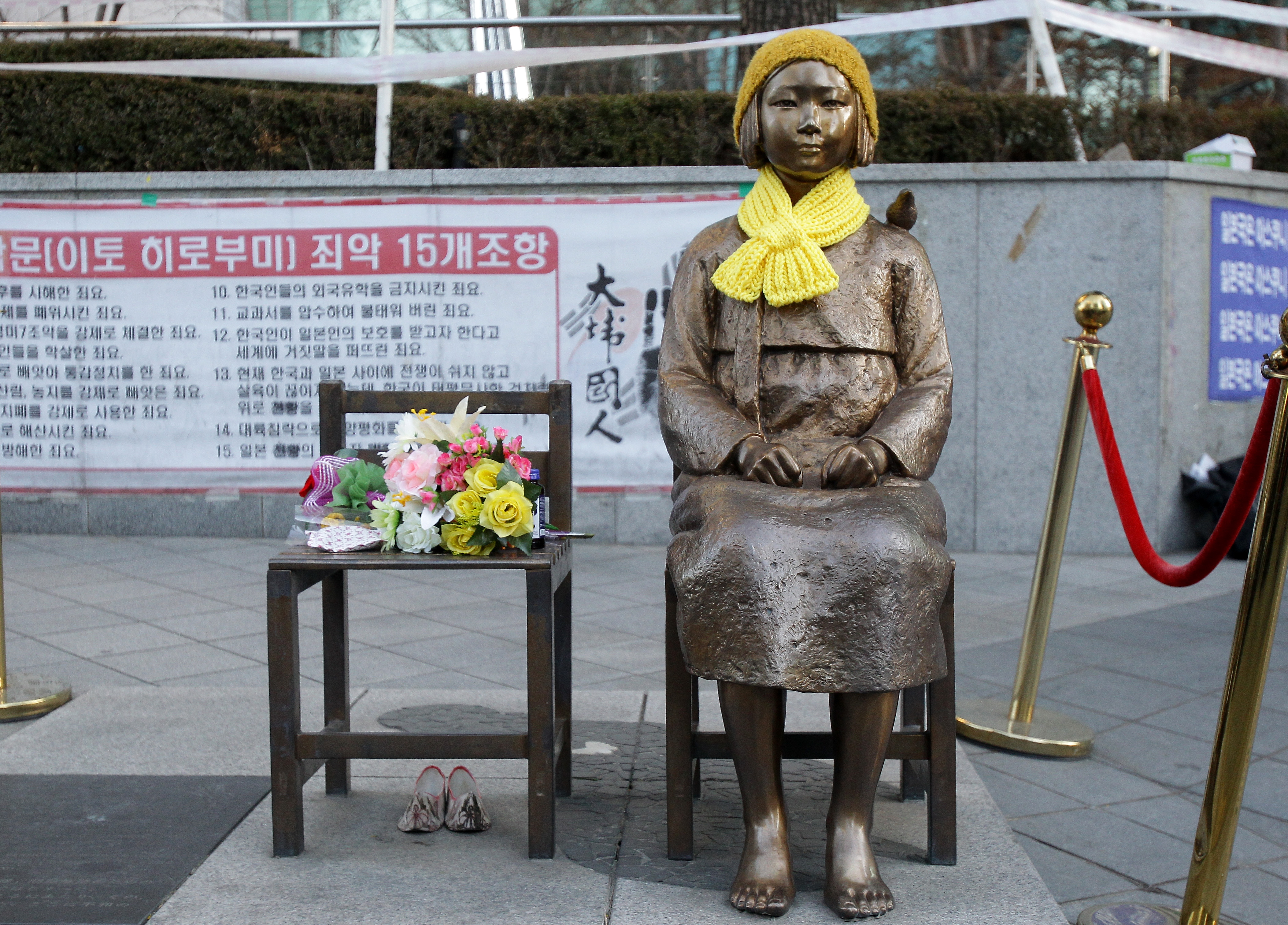 A statue of a girl symbolizing the issue of 'comfort women' in front of the Japanese embassy in Seoul on Dec. 28, 2015