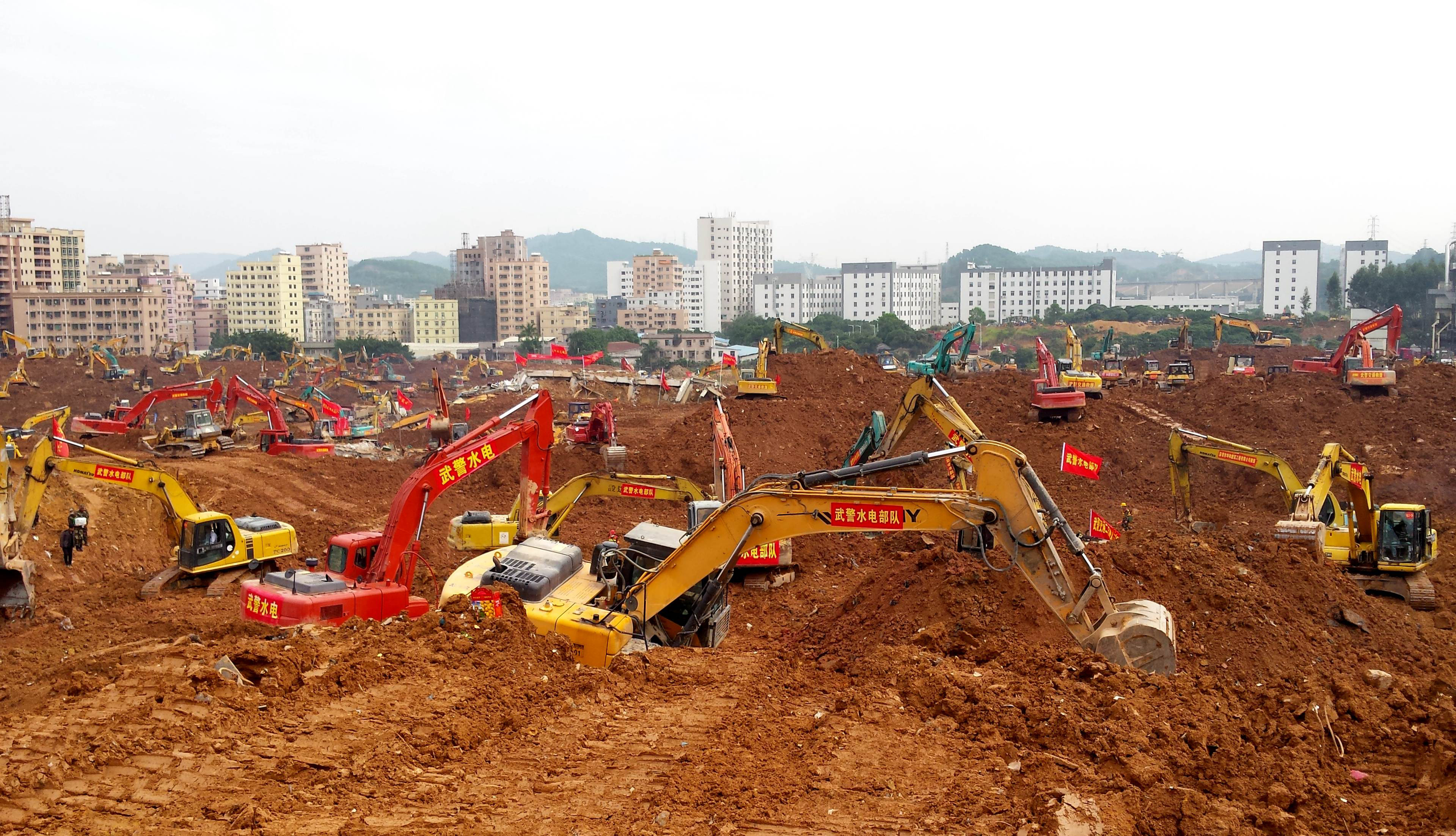 Excavators are seen working at the site of the landslide in an industrial area in Shenzhen, southern China's Guangdong province, on Dec. 28, 2015